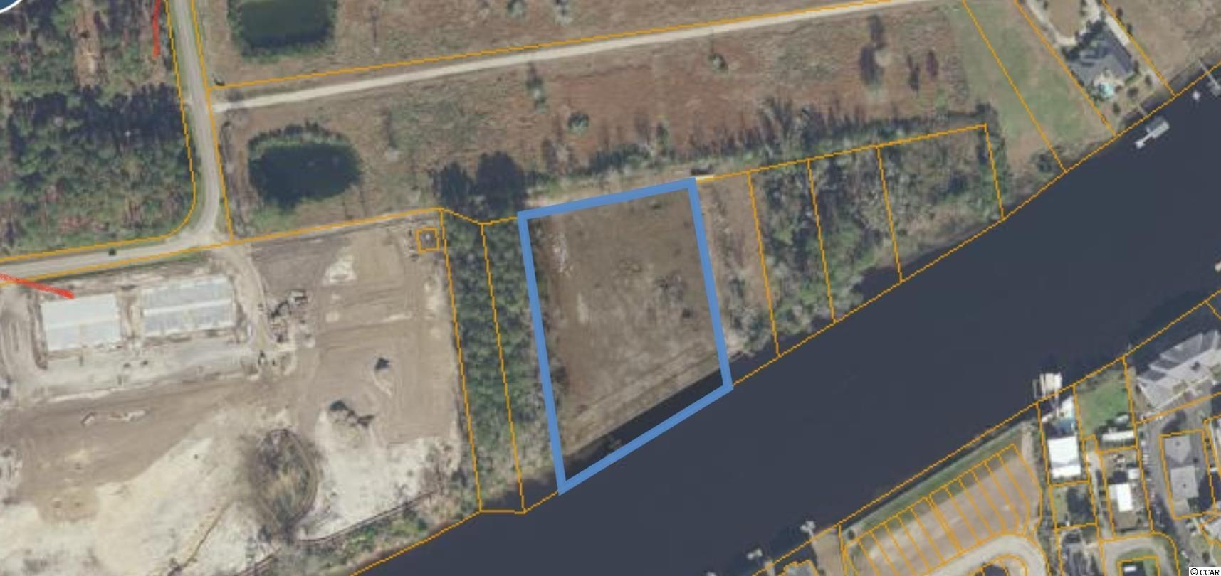 3.2 acres with approximately 350ft directly on the Intacoastal Waterway including a seawall and dock in North Myrtle Beach just off of 31 and short distance from Main Street in North Myrtle. No HOA or subdivision.  Land is mostly cleared.  Anyone looking for a large private home on the waterway then look no further!  Property is perfectly situated just off of highway 31 in North Myrtle Beach and only minutes from all area attractions, shopping, golf, entertainment, major roadways and sandy beaches.  Other options for the property are being looked into including subdividing and other residential uses.  Not another property on the waterway left like this anywhere in our market, get this one before its gone!