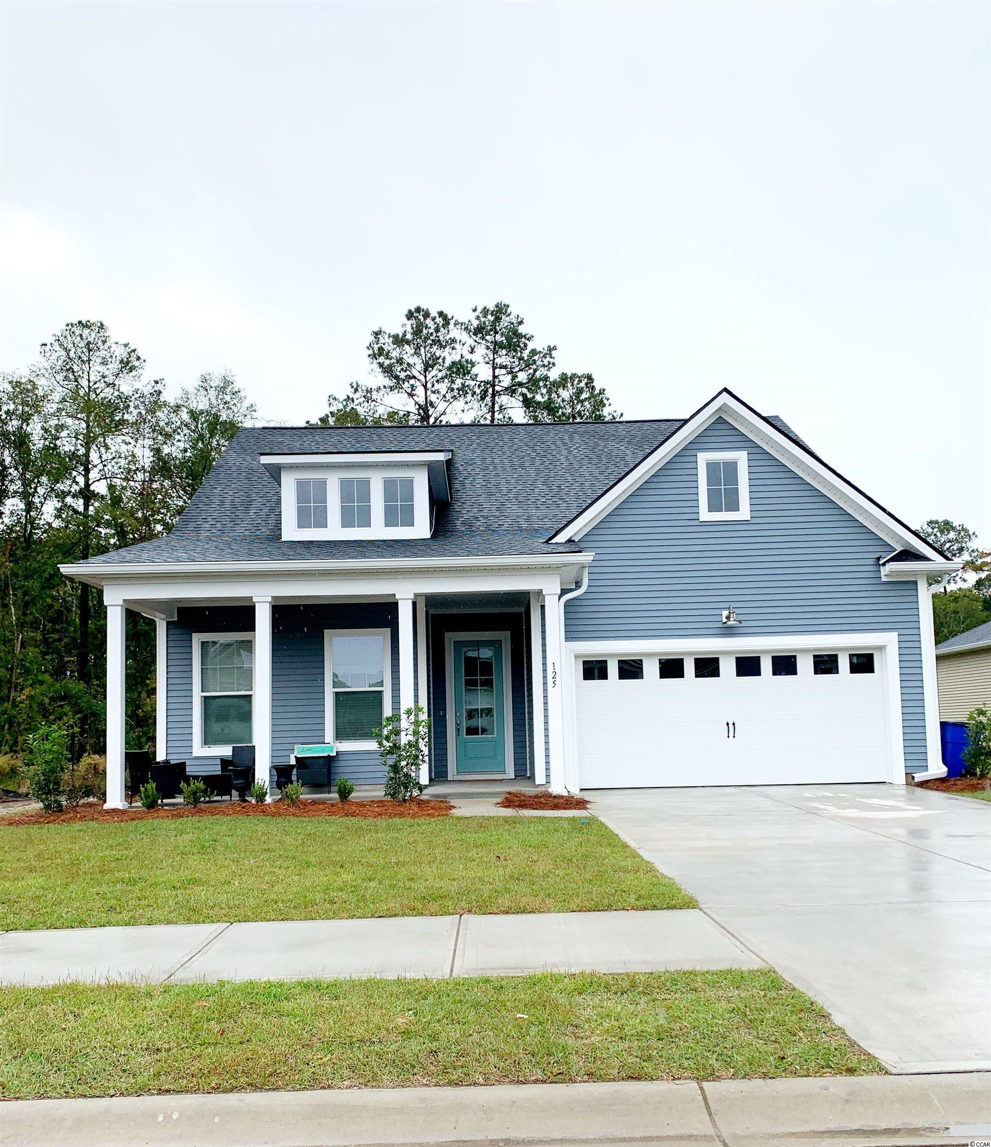 NEW COMMUNITY! Wren Bay boasts over six acres of pristine ponds, 2.5 acres of wetlands, and 2.8 acres of green space. The resort style swimming pool will offer a sundeck, bath house, and outdoor gathering space. Easy access to everything you need right outside your door! We are just 5 miles from the crisp blue waters of the Atlantic Ocean, 3 miles to Marshwalk, and just minutes from retail and grocery shopping.  This Magnolia Plan offers an open concept with soaring 10ft ceilings on first floor, 4 bedrooms, 3 full baths, powder room and 2.5 car garage. Second floor includes 9 ft. ceilings, a large bonus room with closet, fourth bedroom and full bath.  Design features include Gas range, EVP plank flooring in main areas, double door entry into the Master Bath with cultured marble 5ft shower and so much more!  The garage is a wood workers dream with a tandem garage, that can be used as a workshop, golf cart bay, or extra storage! Security System with first 6 mos. of monitoring free, tankless hot water heater.