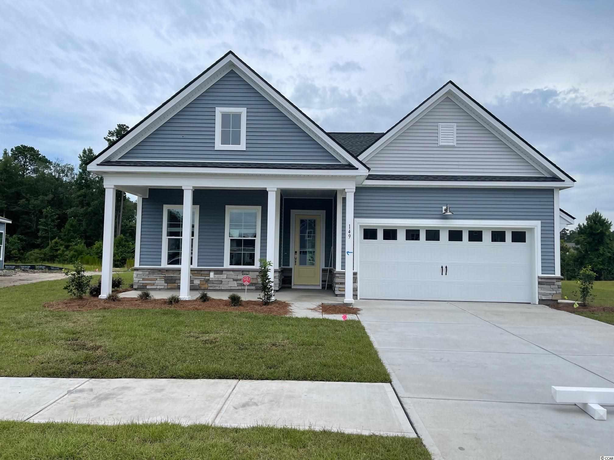 EXCITING NEW COMMUNITY! Wren Bay boasts over six acres of pristine ponds, 2.5 acres of wetlands, and 2.8 acres of green space. The resort style swimming pool will offer a sundeck, bath house, and outdoor gathering space. Easy access to everything you need right outside your door! We are just 5 miles from the crisp blue waters of the Atlantic Ocean, 3 miles to Marshwalk, and just minutes from retail and grocery shopping. This Madison home offers an open concept with soaring 10ft ceilings, upgraded kitchen, hardwood flooring, Rear covered Porch, double door entry into the Master, and double sinks. The garage is a wood workers dream with a tandem garage, that can be used as a workshop, golf cart bay, or extra storage!