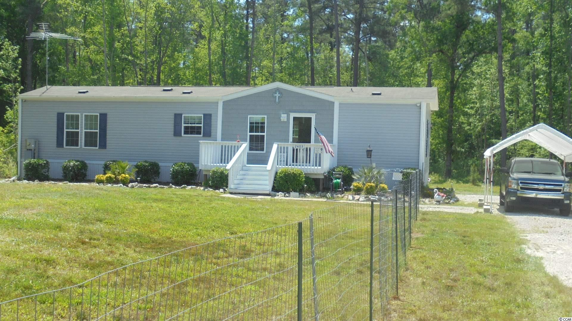 Wonderful country location. This 2017 single wide manufactured home sits on .76 acre of ground. Fenced front yard. Front deck,  covered10 x 16  back deck. Watch the wildlife roam. Hunter ceiling fans in both bedrooms and living room,10ft ceilings, blinds, gutters, Vinyl and carpet flooring. Easy access to town, river, and the beaches. NO HOA fees or deed restrictions here. This is a terrific place to call home. Carport stays.