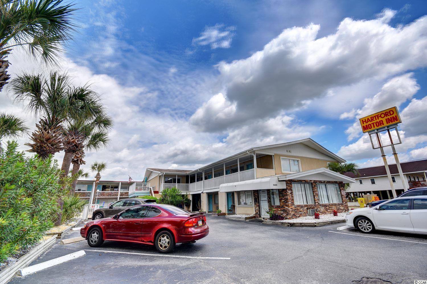 """Unique 3 bed, 3 bath condo within walking distance to the ocean in the charming Hartford Inn! This versatile unit can be used as 1 condo or as a """"lockout"""" 3 bedroom condo. There is a full kitchen in the main living area. Hartford Inn offers an outdoor pool and is located in the quaint Cherry Grove section of the Grand Strand right across the street from the ocean. The HOA for this community covers ALL utilities (including electricity in the unit) as well as insurance on the building. The Cherry Grove area is highly sought after and offers easy access to Highways 17, 9, 90, and 31. There are plenty of restaurants, grocery stores, gas stations, and hospitals nearby and Barefoot Landing, Tanger Outlets, and other entertainment can be reached in less than 15 minutes. This one won't last on this market so put it at the top of the list and grab it while you can!"""