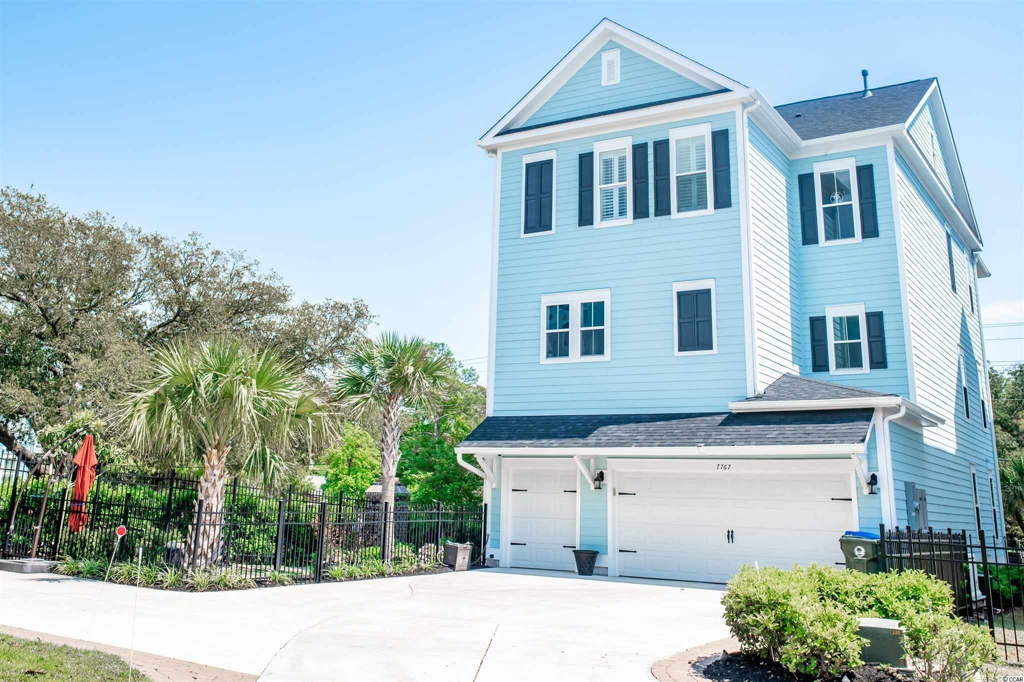 Throw a towel over your shoulder and walk to the beach from this gem of a home located directly on North Ocean Blvd! This three-story home has everything you could want in a beach house or multigenerational home. It boasts high-end finishes including upgraded tile and hardwoods throughout. High ceilings are accented by tall windows with plantation shutters. The elevator services all floors and is conveniently located next to the garage entrance. The first level features two spacious bedrooms, large closets, and an upgraded bathroom with frameless glass shower enclosure and granite countertops. Feel the salty ocean breezes from the first-floor porch swings—one of three that span the entire front width of the home. This home also offers full-size washer/dryer laundry rooms on both the first and third floors. The second floor is dedicated to living space with a large open kitchen featuring a center island cooktop, huge farmhouse sink, soft close cabinet doors and drawers, separate wet bar area with wine fridge, and upgraded Kenmore Elite appliances. The center island has custom pull-outs for easy access to pots and pans along with a clever spice drawer at your fingertips. Next to the kitchen is a big pantry with plenty of space to store supplies. The kitchen opens to the living room spanning the entire front of the home with a gas fireplace and windows all the way around, spilling in the warm sunshine. Spend time around a family meal on the expansive middle porch with fans and bistro lighting. The third floor of the home features a spacious 16 X 19-foot master suite with tray ceiling and two more bedrooms that share a jack and jill bathroom. The master suite is an amazing space with an 8 X 16-foot walk-in closet with custom closet organizer, master bath with both a garden tub and a step-in tiled frameless glass shower surround, and granite counters. Enter the third-floor porch from the master for a peekaboo ocean view. The home also features a large fenced-in side yard