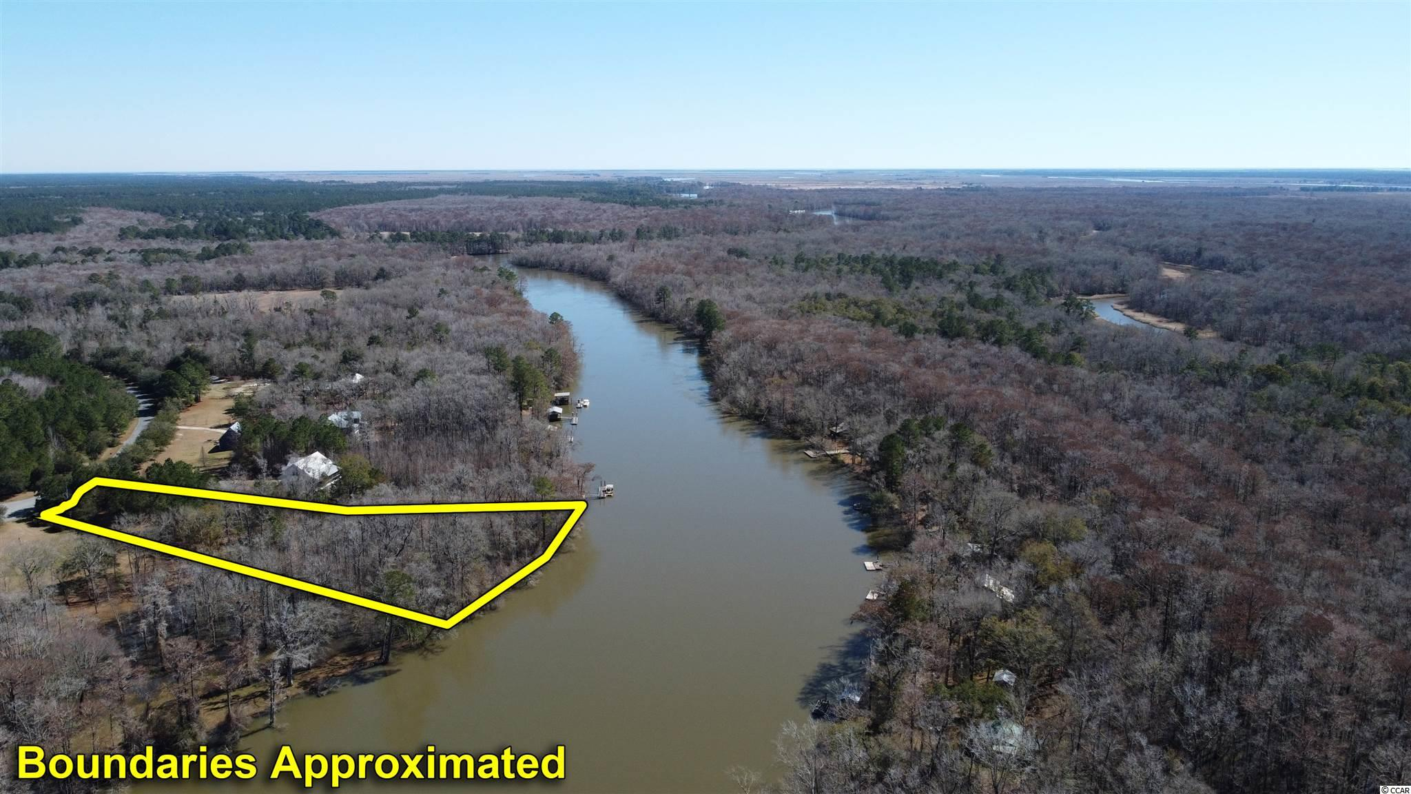 Deep Water - North Santee River. Build your dream house on this 2.67 acre lot in Belleflower Subdivision. With good access to the Atlantic Ocean and just up stream from Hopsewee and The Oaks Plantations, this property offers great opportunities for some of the best salt and freshwater fishing in the Lowcountry. With over 300 ft of deep riverfront you'll have plenty of room to build a sizable dock and pierhead to accommodate your outdoor activities and take in all the pristine natural beauty the delta area has to offer. Nice quiet neighbor hood with underground electricity and municipal water/sewer access. Only minutes to downtown shopping and dining in historic Georgetown and an hours drive to Charleston or Myrtle Beach. Call for your showing today!