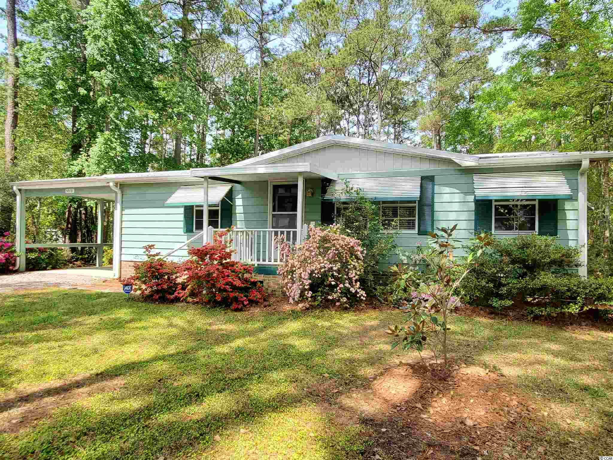Don't miss this sweet cottage!  Close to Huntington State Park, Brookgreen Gardens, beaches, shopping and more, 5078 Pee Dee Lane has been used as a family vacation home. It's never been rented and you can tell.  The sellers have  updated and renovated it over the years. The security system is active and can be transferred to new owner.  The metal roof was put on in 2011 and the screened porch was added at that time.  The HVAC system is 8 years old.  The Carolina Room has been undergoing renovations that you can complete to your satisfaction.  There is an outside shower to wash away the beach sand, workshop and fenced backyard. The kitchen has been renovated including cabinets, countertops, flooring and more. There is a Terminix contract which can be assumed by the buyer for a fee. The lot is 95 X 200!  NO HOA  and more!