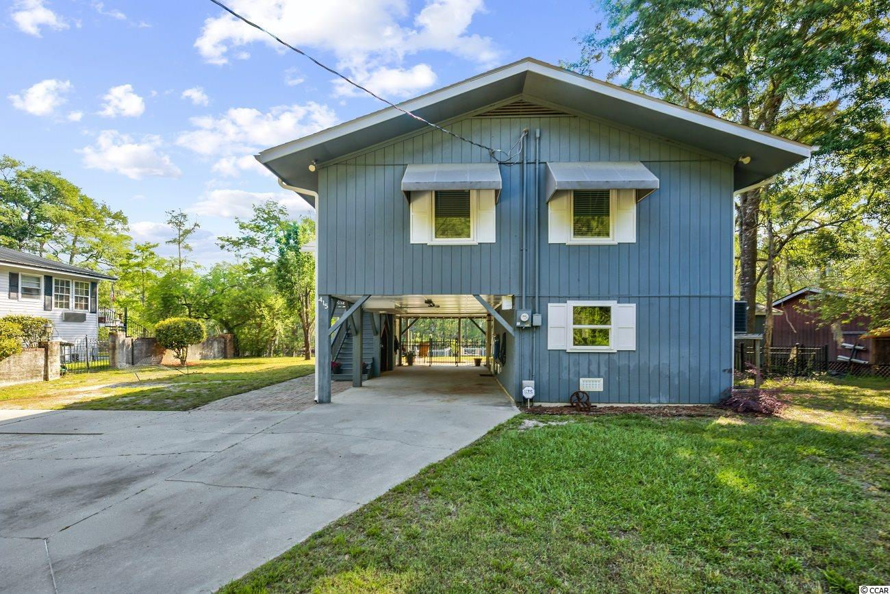 Attention Water Lovers: Fall in love with this 2 bedroom, 1 Bath raised home located on the beautiful moss draped Waccamaw River. Bright and cheerful, this home will be the location of many fun-filled fishing days or lazy days on the water. New Roof end of 2019. 30 foot floating dock with 2 wings (10' X 10' and 10' X 12' approximately), and completed with a full seawall & a bulkhead, modernized stationary river deck, and a fish cleaning station. This home offers beautiful hardwood & tile flooring, crown molding, spacious main living area, dining area overlooking the water, kitchen with side by side stainless steel refrigerator with ice and water door dispenser, and ample counter & cabinet space. Large glass sliding door leads out to your  balcony and the perfect spot to just relax and enjoy nature. Bedrooms come complete with ceiling fans and walk-in closets. The bathroom updated with newer vanity & toilet and has a walk-in shower. Outdoor speakers. The ground level provides great storage. RV hook-up. This home provides you close and easy proximity to the beach and golfing via International Drive  and a short boat ride to Conway, with fine dining, wonderful world-class entertainment, fishing piers, exciting shopping experiences on the Grand Strand, Conway's antique shops, and the River Walk. Just a short drive to medical centers, doctors' offices, pharmacies, banks, post offices, and grocery stores. Quaint and adorable, this home also has NO HOA so you can really relax and enjoy your quiet time!!! Home warranty provided by seller.
