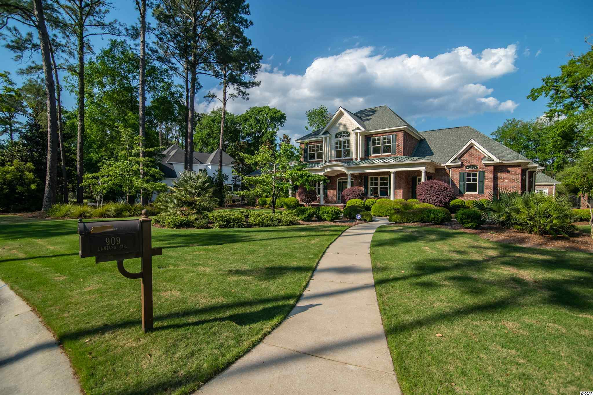 Stunning, traditional brick home located in the highly sought after, coastal, low country community of DeBordieu.    This home truly is a stunner!  From the moment you pull up to this property located on a ¾ acre corner lot with lake view, you will be delighted by the custom landscape and attention to detail.  Featuring 4,985 of heated luxury square feet there isn't much this home does not offer to potential owners.  Beginning with the 2-car attached and 2-car detached climate-controlled garages with professional epoxy floors this will make any car buff thrilled. The garage area also features an attached 300 square foot climate-controlled workshop as well as additional golf cart garage with separate entrance and lots of additional storage.  The back yard features a luxury oasis that includes a 579 square foot rear porch with tile floors, fireplace, ceiling fans and remote-controlled screens that can be activated with the touch of a button. To top it all off, this home features a built in Gunite pool with deep end, full irrigation system, remote control gate, outdoor shower, pool bathroom and full outdoor kitchen.    Once inside, this home offers even more features than outside!  From custom closets, fixtures and flooring this home will make living in the low country a dream.  The main floor features two-story entrance hall with barrel ceiling, two story great room with floor to ceiling fireplace, surround sound system throughout including rear porch, built in cabinets and professional custom kitchen with eat in dining area, walk-in pantry and heated tile floors throughout the main level.  Also on the main level is a formal dining room with custom genuine turquoise/Iron chandelier as well as a study/office that features custom coffered ceiling and lighting.   The large master suite downstairs is one of a kind with a 15 by 11 custom walk in closet, cedar lined built in Sauna, Jacuzzi tub, large shower w/bench and two separate vanities with lots of storage.   Upstairs 