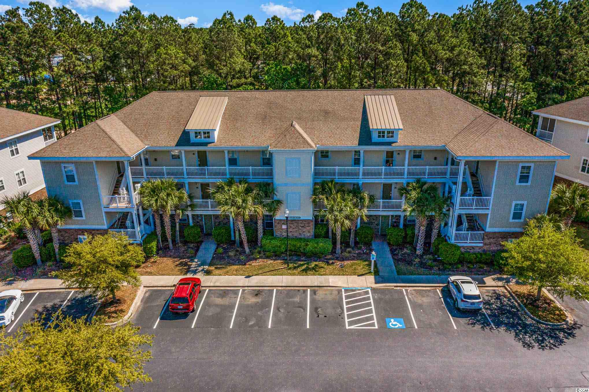 Look no further as your own personal piece of PARADISE awaits you in this top floor, charming and stunning 2BR/2BA golf villa! This villa is located on the Norman golf course in Willow Bend of the popular Barefoot Resort and Golf in North Myrtle Beach! Step right into this lovely unit and you'll notice the bright & cheery open floor concept as your kitchen opens up to the living/dining room combo and vaulted ceilings in the living area. Look at that beautiful accented tray ceiling in your master bedroom! The master bedroom includes two spacious closets and a master bath. You have a full second bedroom and bathroom for your guests. Enjoy your morning coffee or afternoon beverage of choice on your screened in porch, which has a storage unit. This unit comes FULLY FURNISHED minus a few personal items, silverware and bedding that do not convey. A laundry room with washer/dryer included as well. The owners have completed some wonderful upgrades to really give this villa character and the modern flare of today! Some of those include the gorgeous granite countertops, stainless steel appliances, a new storm door, luxury vinyl flooring throughout the living/dining room, freshly painted throughout, 2 new sofas(one a queen size pull out bed), new mattresses in both bedrooms(new queen bed in second bedroom), new ceiling fans in bedrooms, had porch screened in, and hot water heater is only two years old! Willow Bend has extra parking for your guests, and a private pool, which is a pleasant alternative to the beach. Speaking of heading to the beach, it's just a short ride down to your very own private oceanfront cabana with a gated parking lot only accessible to the Barefoot owners! There is currently a new cabana that is under construction targeted completion sometime in 2021! The gated and monitored parking lots are still available to you now! There is also a free shuttle bus ride to and from the beach as well. Enjoy maintenance free living as your HOA fee in Willow Bend covers