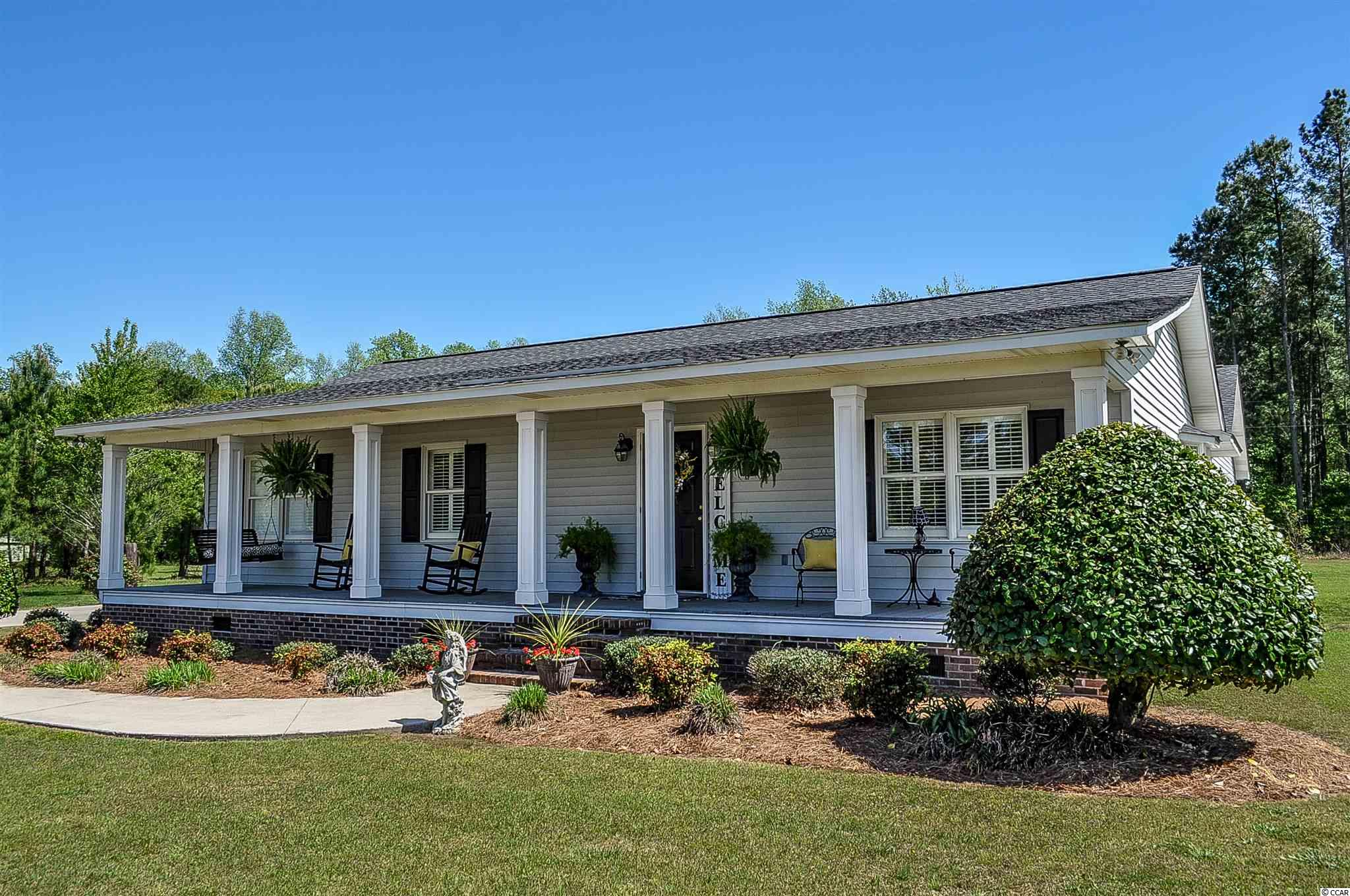 Enjoy the peace and quiet of country living! Convenient location just minutes from shopping and historical downtown Conway, this well maintained 3 bedroom, 2 1/2 bath home features both .69 acre of land and no hoa!  From the welcoming front porch and well manicured landscape to the cozy living room, this property instantly makes you feel right at home. With the long driveway and oversized side load garage you have ample room for a boat or RV.  Additional storage 6x24 in rear of garage.  Separate laundry room with washer and dryer. Home has hardwood flooring with laminate in the bedrooms, solid surface countertops in kitchen, and plantation shutters throughout.  Roof replaced in 2016. Close to schools, dining, shopping and a short drive into Myrtle Beach. This home is truly a must see to appreciate.  Call for your appointment today!