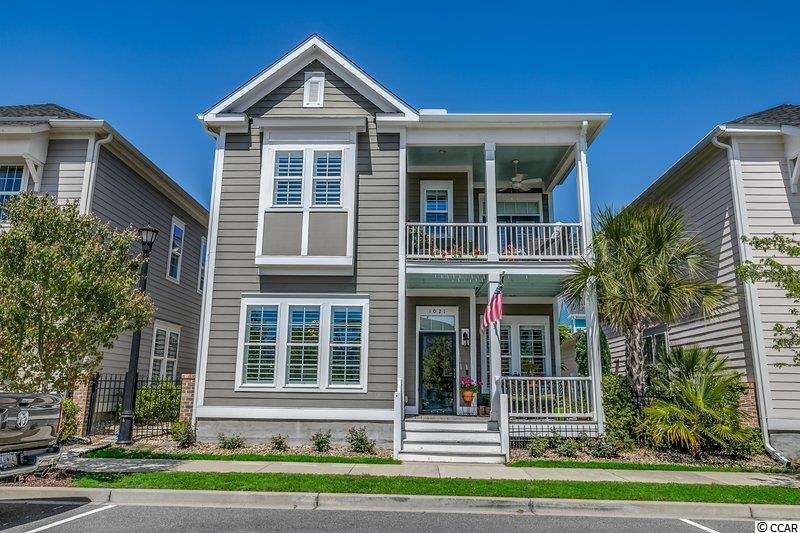 Don't miss the opportunity to live in an area of Myrtle Beach that is highly sought after.  This 5 BR/ 3 1/2 BA home located in Sweetgrass West in Market Common is immaculate and only a short walk to the parks, walking trails, shops, restaurants, movie theater and other amenities of living in Market Common. When you enter the home you will find an open floor plan that is great for entertaining. The kitchen features solid surface counter tops, a gas cooktop, breakfast bar/ work island, walk-in pantry and much more. There are 2 Master Suites, one down and one upstairs. There is a hookup for a Washer and Dryer on both floors, the laundry room is on the first floor. Outside you will find 2 covered porches for enjoying coffee or sitting and relaxing. Also outside you will find a patio gives you space for entertaining or just relaxing. Schedule your showing today.