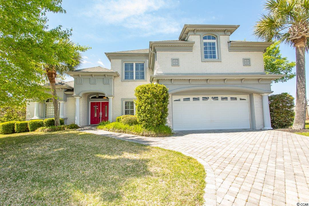 """This beautiful custom-built all brick, 4 br 2.5 ba lakefront home comes with a beautiful PRIVATE POOL in the highly desirable upscale and gated BLUFFS ON THE WATERWAY in Carolina Forest. The driveway has a high-quality pavered driveway creates a ambience entrance to this gorgeous custom-built home sitting in a quiet cul-de-sac on an extra large 1/3 ac lot overlooking the lake.   The 16 ft ceilings and custom arched doorways lead into a bright and open great room with a wet bar. The Master bedroom is on the 1st floor with an exquisite tray ceiling and extra large walk-in closet. The spacious master bath has a relaxing whirlpool garden tub, a large tiled shower, custom towel warmers and high-end and unique bathroom fixtures. The large, open-kitchen boasts stainless appliances, numerous high quality custom cabinets, a large glassed-door pantry with an additional storage area, which overlooks a very inviting """"keeping room"""" with a beautiful fireplace. The other large bedrooms with walkin closets are located on the 2nd floor.  There is a large, convenient desk area in the landing area.   There's an extra large (20 x 25') bonus room which can be used as a 4th bedroom or game room or theater room. entertain family and friends on the enormous and breathtaking inviting 41' x 12' all weather patio which overlooks the pool and the lake and fountains. Theres a 200 gal propane tank for the gas fireplaces, the grill area and the 2 tankless Rinnai water heaters. The home has a whole house central vacuuming system as well.  This amazing home has very expensive plantation shutters in all the bedrooms as well as in the formal dining room which can be converted to a flex room or office.  The marble windowsills are another addition to make this home more beautiful.  In all there are eleven ceiling fans throughout the home.  A beautiful wrought-iron black fence encloses the beautiful backyard oasis with beautiful landscaping and gardening areas.  The seller will provide a 1yr home warran"""