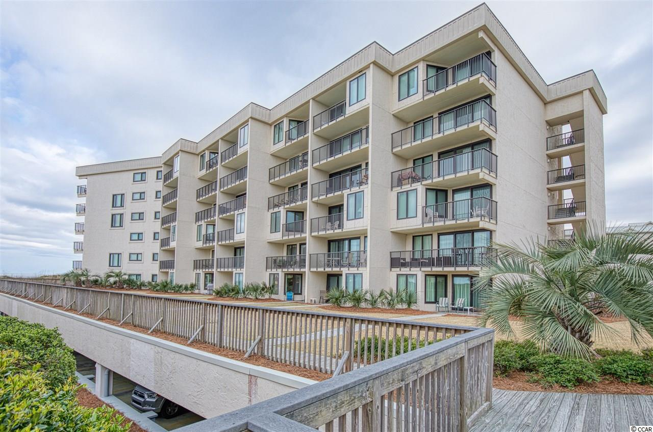 WOW!! This two floor condo in Litchfield by the Sea has direct access to the beach.  Enjoy a gorgeous view of the pristine beach from your balcony or head directly out to the sand from your back door.  Each of the bedrooms have their own full bathroom and the expansive master bedroom has two separate bathrooms that connect to a shared shower and soaker tub.  Litchfield by the Sea is a gated community with a 24 guard at the gate.  Amenities include private beach access & oceanfront clubhouse,  miles of walking & biking trails, tennis courts, fishing pier, crabbing docks and some amazing restaurants.  You are minutes from Brookgreen Gardens and Huntington Beach State Park.  You will fall in love with the gorgeous live oak trees and amazing atmosphere as soon as you drive through the gate of Litchfield by the Sea!
