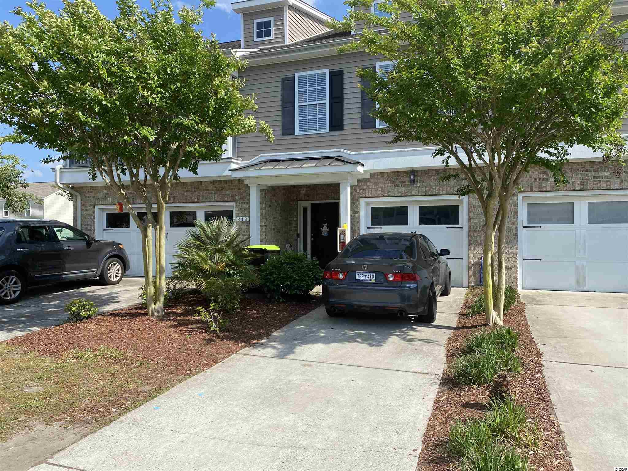 Great opportunity to own a very nice townhome in Planter's Point at The Farm in Carolina Forest. This townhome offers 2 bedrooms,2 baths high ceilings, tons of natural light, open kitchen with plenty of cabinets. new laminate and carpet throughout, a wrap around screened balcony where you can enjoy your morning coffee and a 1 car garage that can hold two cars !  This home is convenient to International Dr, Highway 31, the beach and everything else the Grand Strand has to offer. Don't miss this one !