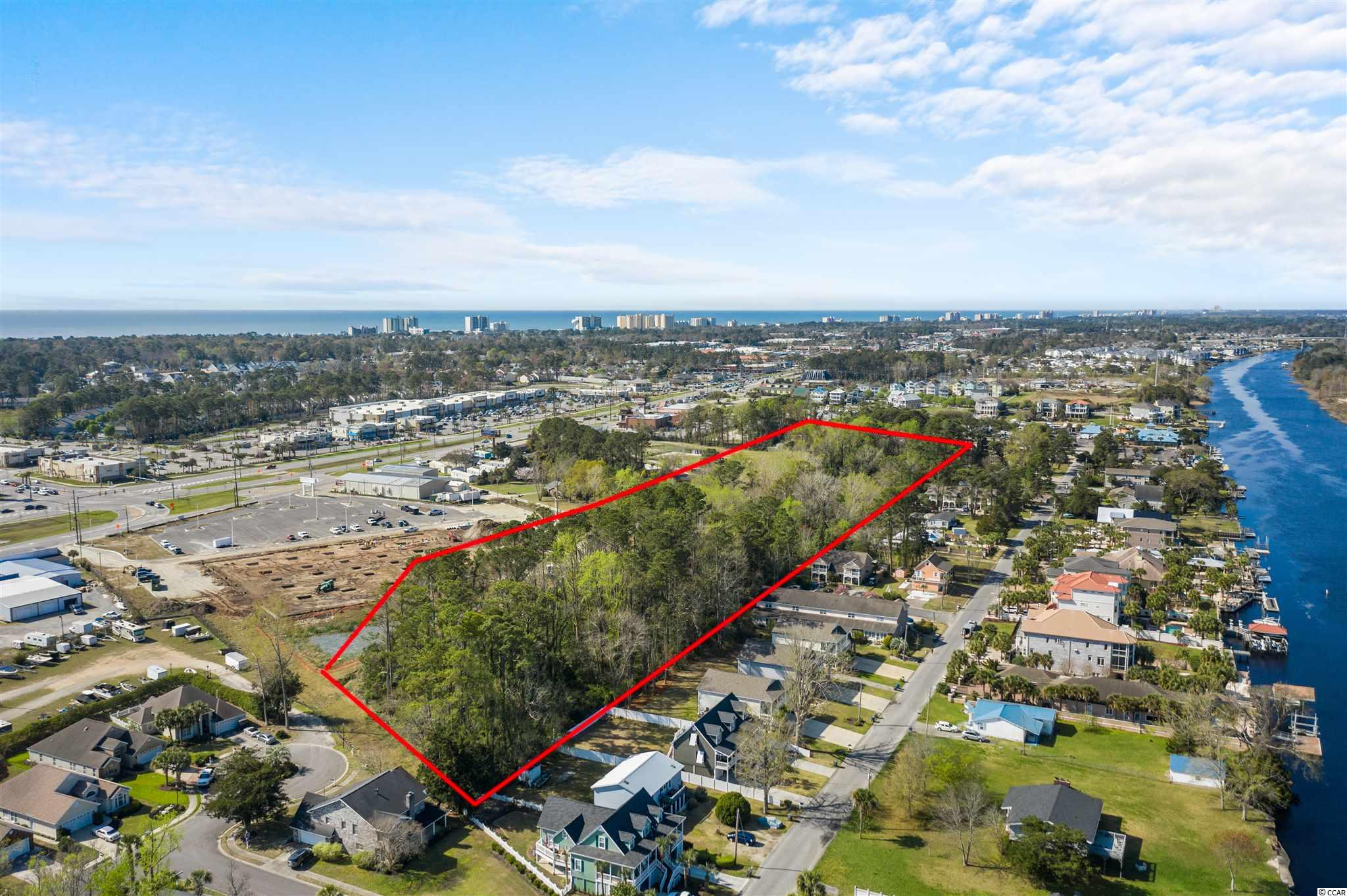 Extremely rare opportunity.....5.12 acres of prime development land ready to be developed.  This unique tract is centrally located in the heart of NMB, just a stone's throw from the Intracoastal Waterway and a golf cart ride to the beach.  This is the spot for the next upscale, quaint neighborhood in North Myrtle Beach.
