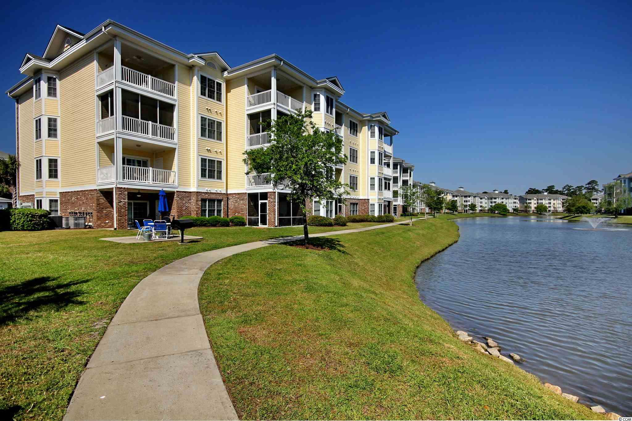 A spacious 3Bed/2Bath END UNIT Condo in Magnolia Pointe with a private screened balcony overlooking the pond - an elevator building in a beautiful, well planned and superbly managed golf course community delivering easy living in Myrtle Beach. Open concept & spacious with a large balcony and panoramic views of the pond, fountain and green space! All rooms are centered around the large, open kitchen. Relax and enjoy oversized rooms, a split bedroom floorplan, end unit windows and the peaceful balcony. This unit has been well maintained and would be perfect as a primary residence, short term or long term rental. Multiple pools, walking trails, lush landscaping, palms & flowering shrubs fill the common areas at Magnolia Pointe. So, so close to everything – Close to Hwy 17 Bypass, Hwy 17 Business, Hwy 31, Hwy 501, Shopping, Dining, Entertainment, Medical, Recreation & a golf cart ride to the beach!