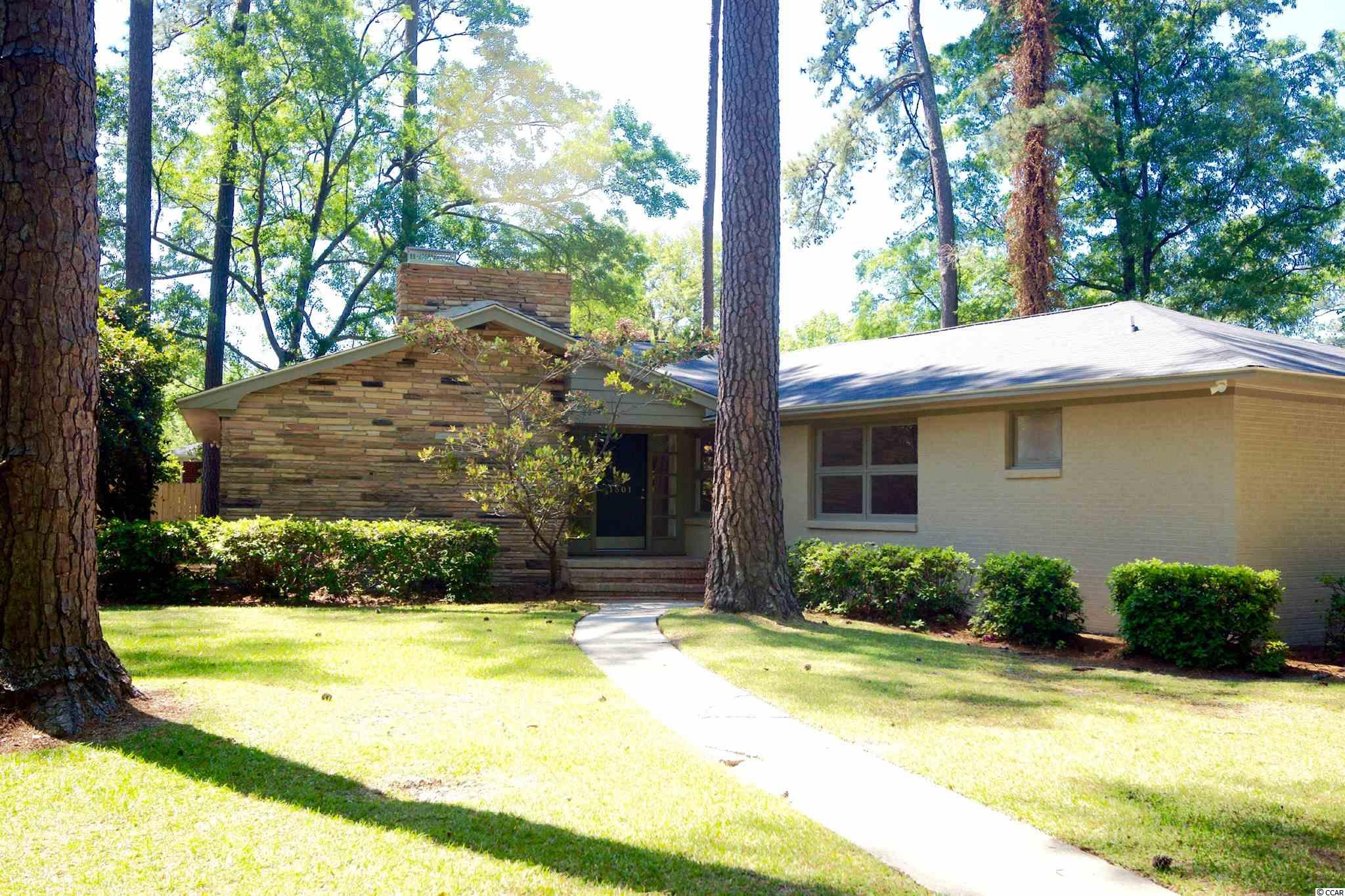 This Charming Conway Mid Century Modern Home has been completely redone.  From TOP to BOTTOM...new Roof and blown in isulation, new pex pipe plumbing & all Electrical including panel, new 50 gallon water heater & HVAC System along with encapsulation. And don't forget all the interior finishes as well. Both baths have been redone and the kitchen as well.  Hardwoods have been sanded and refinished with remaining areas get High End Luxury Vinyl Planks.  All new LED lighting and fans, interior doors and rear exterior doors. No stone left unturned, this home sells itself.  No HOA, so plenty of room to park you MotorCoach or Boat.  Large beautiful lot with mature trees in a well established neighborhood.  Quaint Downtown Conway just minutes away and Conway Parks & Recreation Center in biking distance.  Schedule your Appointment NOW, Turn Key Homes with this much Character don't last long!!!!