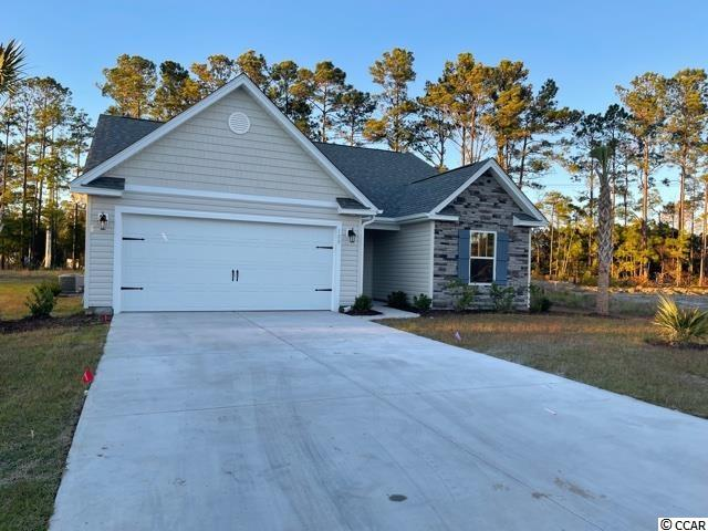 """Natural Gas quiet community located in Little River/North Myrtle Beach only a few miles from the Beach and major shopping! This Emerald plan will be built on a 0.25 ac home site featuring 3 bedrooms, 2 baths. The home includes finished 2 car garage and a covered rear porch!! Open concept kitchen/living room area, granite countertops, crown molding on kitchen cabinets with hardware included. Large tile shower with two shower heads and a bench with granite top. Ceramic tile in all bathrooms and Laundry room, Waterproof laminate in Family Room, Foyer, Hall. Vaulted ceiling in Family room and every bedroom. Wainscot and 5 1/2 """" beaded baseboards for Custom look!! Home also includes TAEXX pest control tubing, lawn irrigation and Ring video doorbell!!!Stone accents on the exterior.  All measurements are approximate *Photos of a similar home* Some items on the photos may be at additional cost. Anticipating completion time end of  2021"""