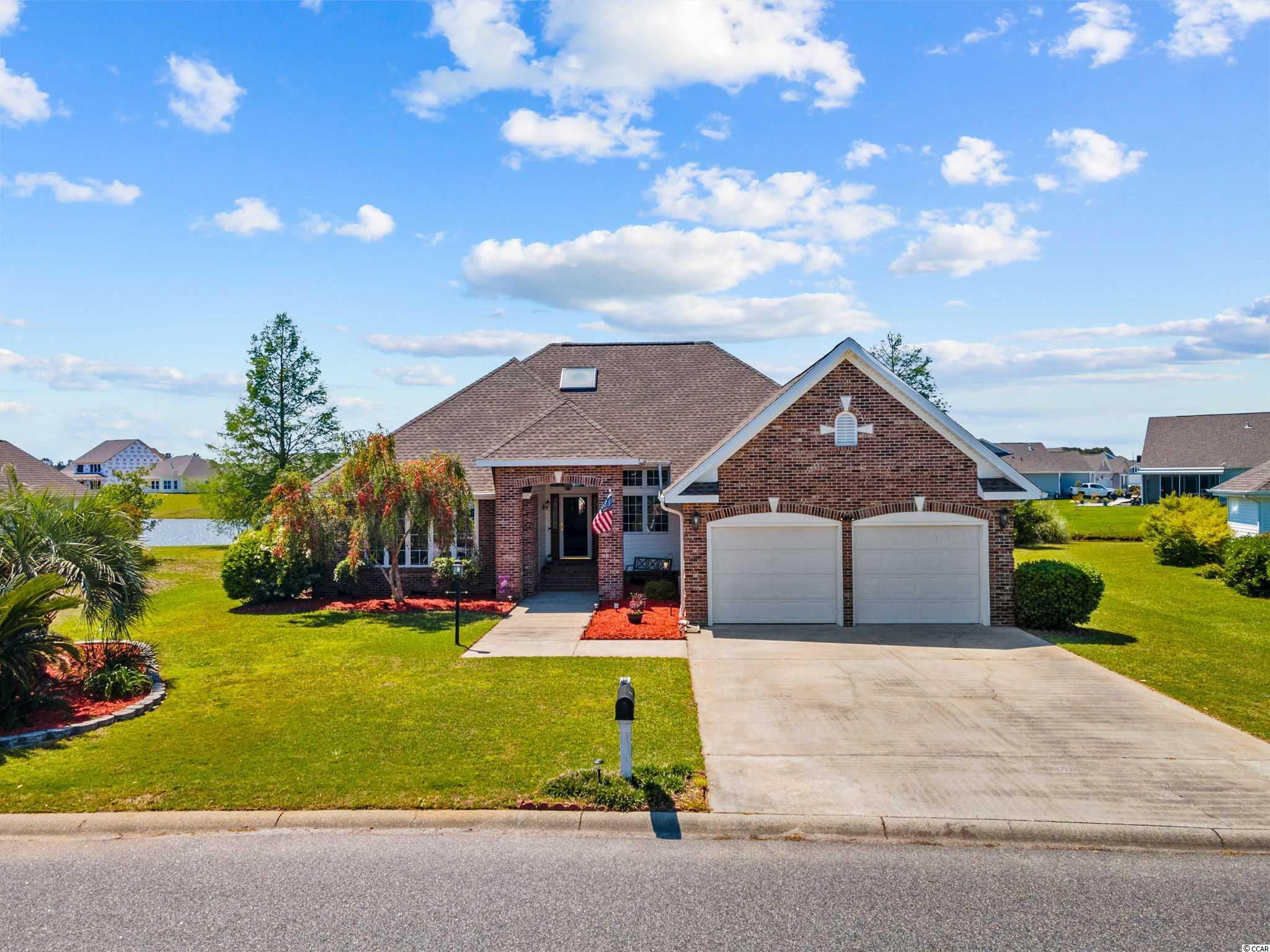 Introducing this elegant custom built 3 bedroom 2 bath home located in the very popular Southwood community. This piece of paradise presents a grand foyer entryway with a large transom window, vaulted ceilings, hardwood, tile & carpet flooring, living room includes a cozy fireplace with gas logs, a versatile family room, and showcases an inviting Carolina room with tranquil lake views. Prepare a delightful meal in your modern kitchen with granite solid surface counter tops, stainless steel appliances, smooth flat top range, built-in microwave, dishwasher, French door refrigerator with ice & water door dispenser & freezer drawer, along with ample counter & cabinet space. Serve your meal in the graceful formal dining area with a sliding glass door access to the relaxing screened in patio. The comfortable master suite features an ideal bump out with memorable lake views and a ceiling fan. The upscale master bath offers a space saving double pocket door entryway, vanity with dual sinks, comfort station, soothing jetted tub, a deluxe step-in shower, and a large walk-in closet. This delightful home is completed with two additional bedrooms, a full guest bath, laundry room, and a 2 car attached garage. This home affords you easy access to the beach and golfing along with all of the other activities and happenings in Myrtle Beach and the new Surfside Beach Entertainment District including fun eateries, award winning off-Broadway shows, public fishing piers, Marsh Walk, and intriguing shopping adventures along the Grand Strand. Conveniently located to your everyday needs, including grocery stores, banks, post offices, medical centers, doctors' offices, and pharmacies. Check out our state of the art 3-D Virtual Tour.