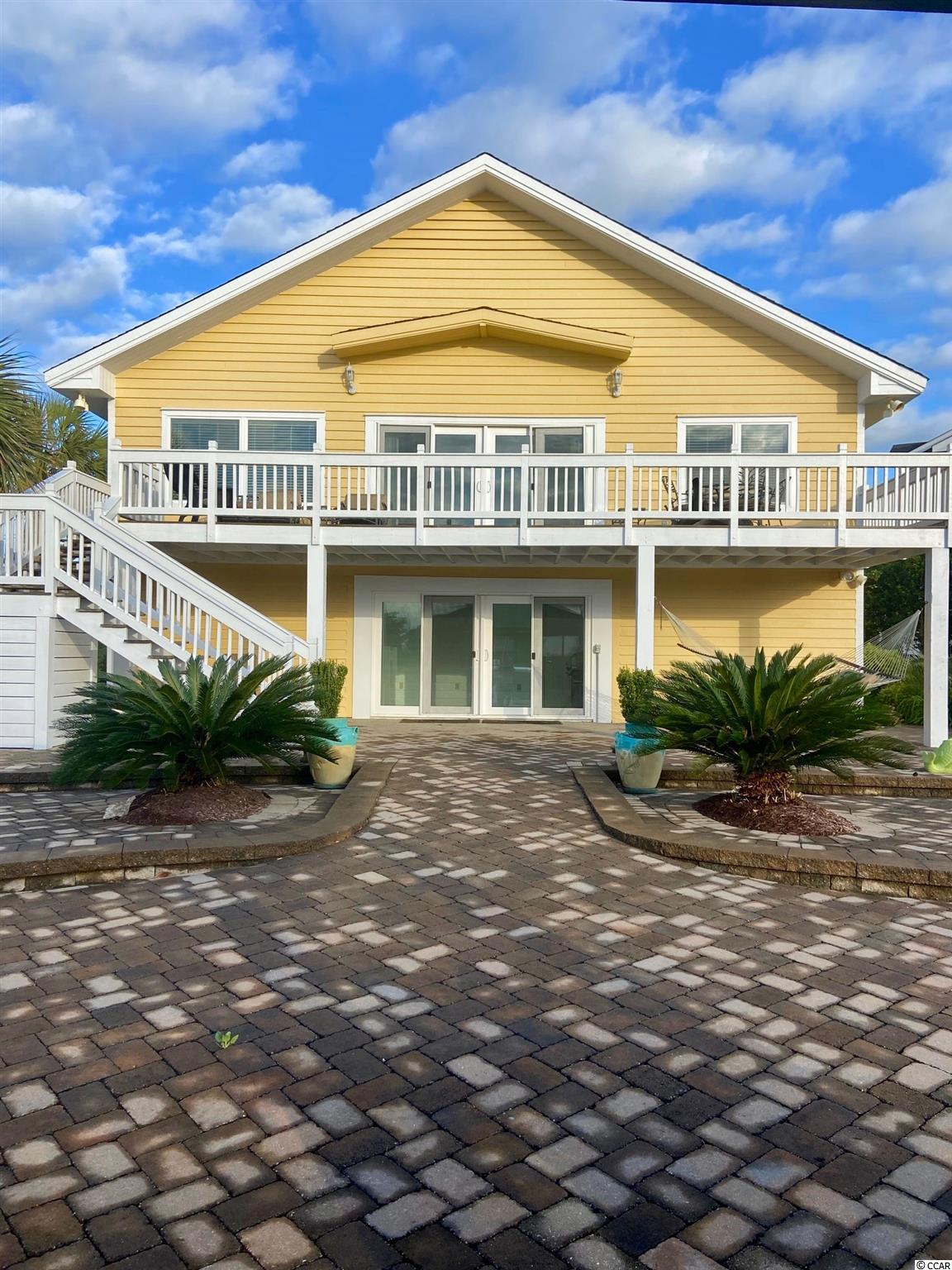 Two story beach home located in Garden City on Oyster Cove canal.  Ocean View, Fixed Dock, Floating Dock, vinyl sea wall, good water at all tides for smaller boats and mid size up to 35ft., fully furnished...interior photos to be added 4/26/21