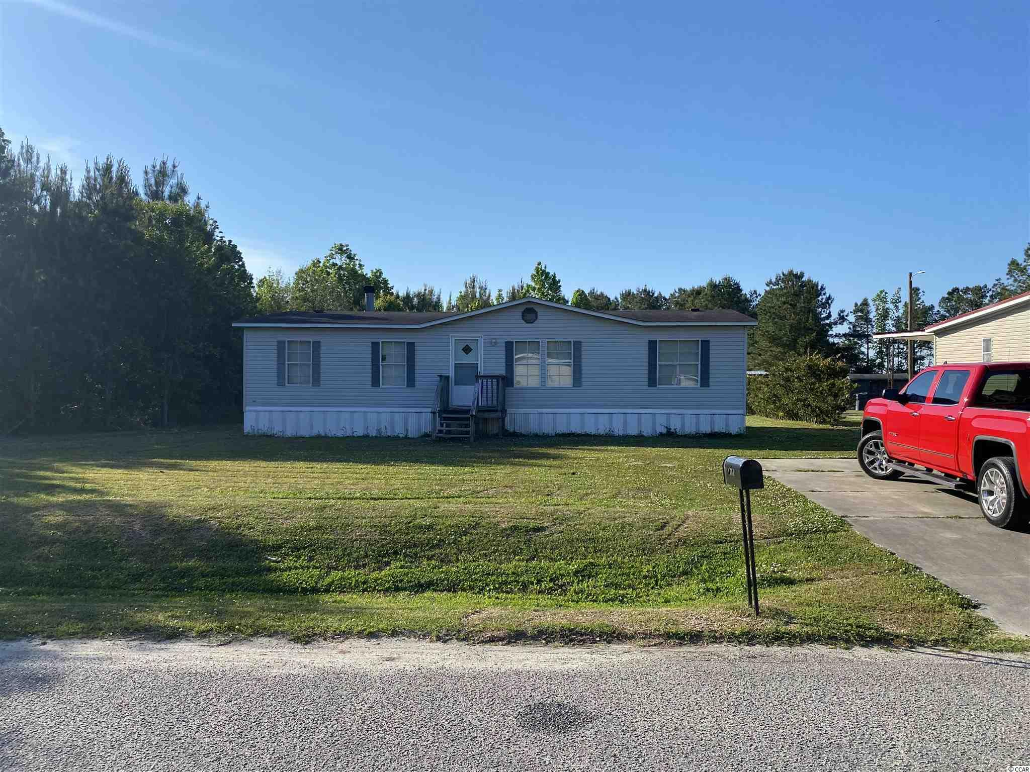 Home has large living room and den with fireplace. Laminated floors and has been freshly painted.
