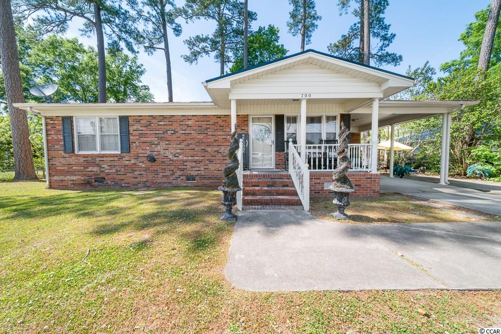 This is a great starter home within minutes of historic downtown Conway and River Walk. Stroll through downtowns shops or walk the beautiful River Walk.  So let's talk about this house! The front yard is well maintain and a great size. The front porch would be perfect for sitting and relaxing with a beverage of choice. There is an additional concrete pad pored to allow more vehicle parking. Attached to the carport is a very spacious storage room. This home has bamboo flooring throughout and title. The kitchen has a title backsplash. Although there are only two bedroom, both bedrooms are spacious. The master has two closets. Schedule your showing today!