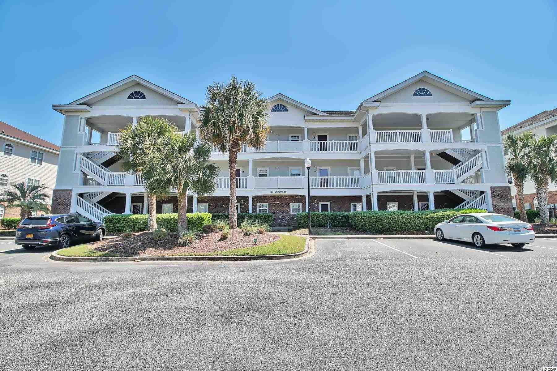 This is a beautiful two bedroom two bath ground floor unit in Wedgewood @ Barefoot Resort. This unit has nice upgrades throughout. SS appliances, solid surface counter tops, tiled back splash, tiled screened in patio. Great view of #15 on the Greg Norman Golf Course. This unit was not on a rental program.
