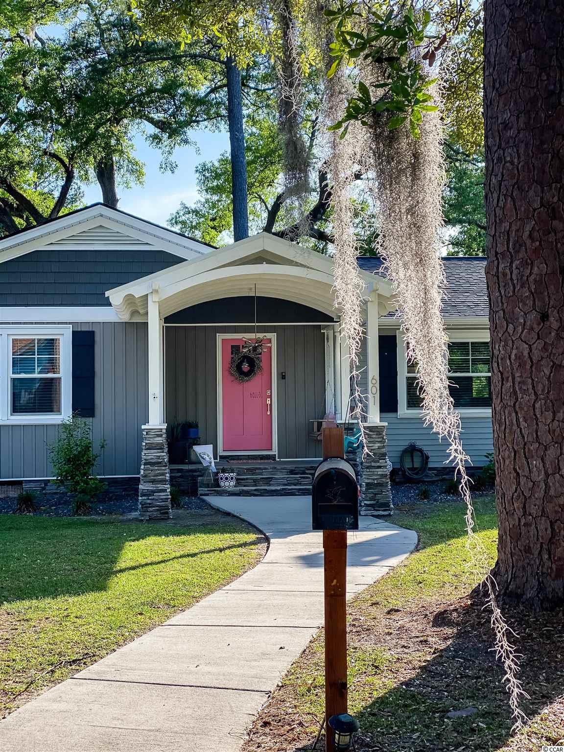 Located on a large corner lot at the intersection of two historic streets.  Your chance to own a recently renovated 3BR, 2BA home in Conway's Historic Downtown has just become available!  This home boasts one of the largest back yards that is fully fenced in and accessible by an iron gate and French doors off the kitchen.  A large deck was built within the past year and is ready for entertaining and relaxation.  The inside is a blend of beautiful old character and updated renovations.  From original hardwoods, to built-in's framing a working fireplace, to thick wooden doors, vintage tiles, ceramic tub and brand new closet organizer systems throughout.  A perfect blend of modern and vintage touches make this home a perfect nest for you and your family!  This home is located a half a mile from the Conway Riverwalk, where you can enjoy much of the Downtown charm that Conway has to offer.  A hidden gem that is within walking distance of Collins Park, Conway Library and many restaurants and boutiques.  *Please note that the current owners chose to have their laundry room outside but the linen closet in the hallway is wired for a smaller stacked washer and dryer unit**  All measurements are approximate and should be verified by buyers.