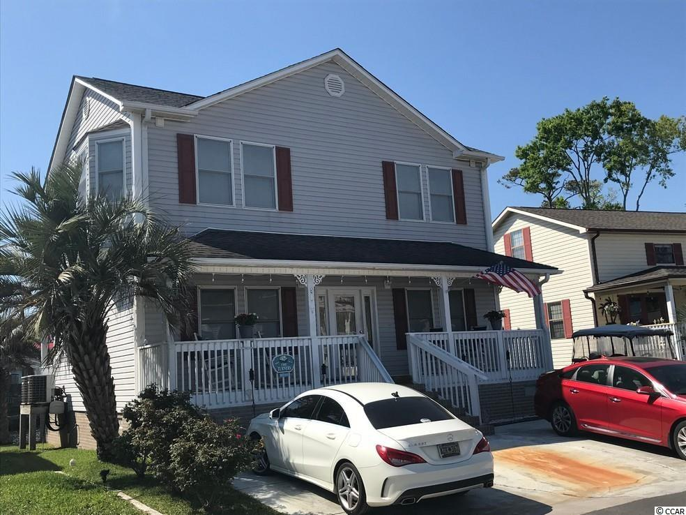 Vaulted Ceilings throughout this beautiful home with a loft type area. Plenty of storage with walk in attic space. Pond Front with an oversized deck. This Home is situated on a permanent site located off of a paved road. All sites are close to the beach and most of amenities that Ocean Lakes has to offer come with the purchase. Ocean Lakes has nearly a mile of beach front. 24 hour security and amenities such as indoor and outdoor pools, water park with a splash zone, golf cart rental, sales and service, lazy river, slides, basketball courts, volleyball and much more when you become part of the Ocean Lakes Family
