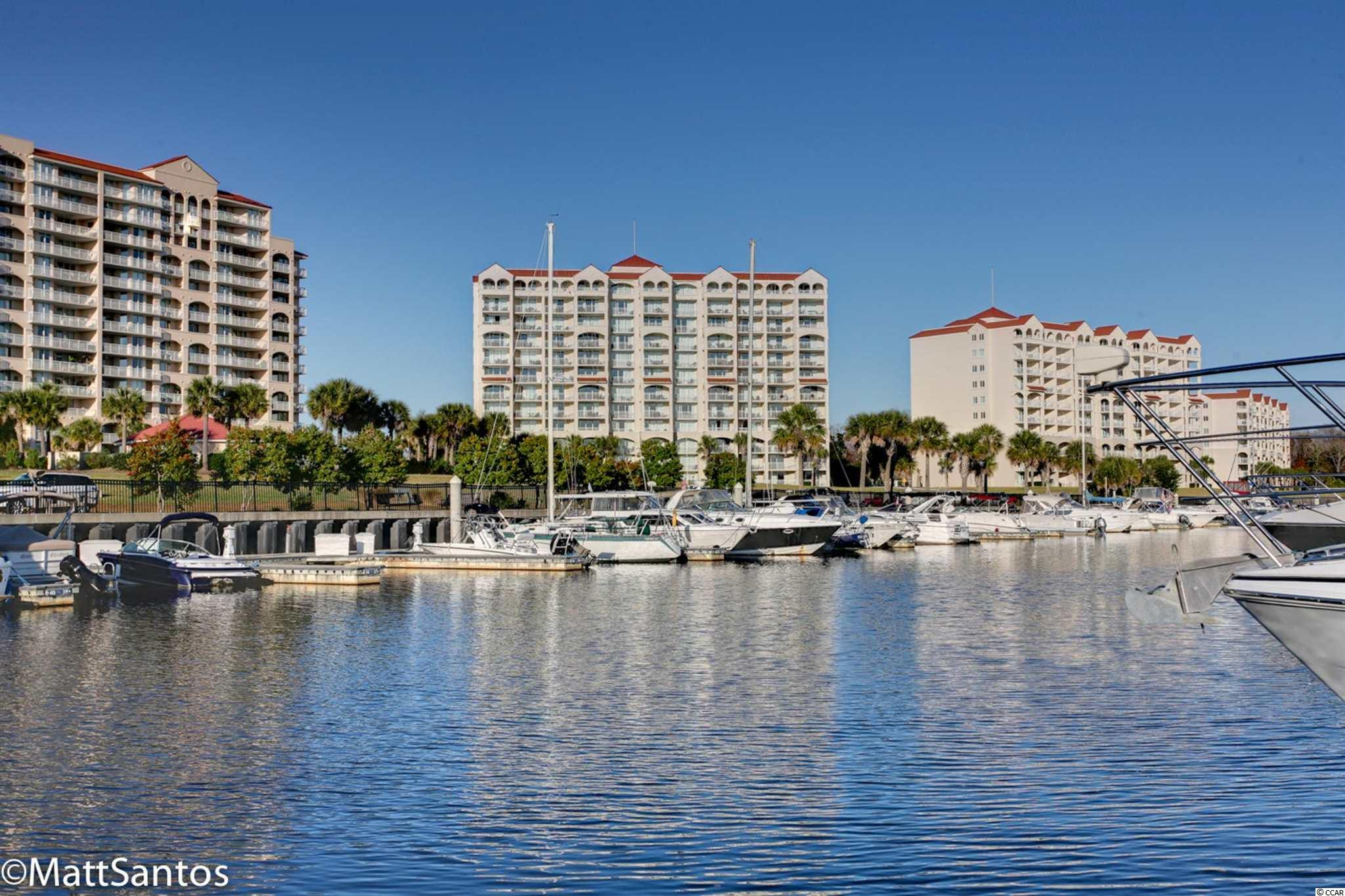 RARE OPPORTUNITY!!! If you love Waterway Living, this beautifully furnished, 4 bedroom/4 bathroom condo with TWO SEPERATE BALCONIES at Yacht Club Villas in Barefoot Resort is A MUST SEE! Enter through the foyer and on each side are the first two bedrooms with their own private bathroom and lockout doors. The spacious kitchen includes all white appliances with a lovely granite countertop. You'll enjoy the pristine vinyl tile and laminate flooring throughout (NO CARPET!!) Washer and dryer are included. This is Coastal Living at its very best with Luxurious Amenities in the North Myrtle Beach area and watch the boats in the marina on the Intercoastal Waterway. Owners are allowed pets. Bring your golf clubs and enjoy a round of golf at one of our 4 top rated golf courses designed by Greg Norman, Davis Love, Pete Dye and Tom Fazio. You are just minutes from The BEST shopping, dining, and entertainment along the Grand Strand. This will be a perfect investment property, second home, or primary residence. HURRY THIS UNIT WON'T LAST LONG!
