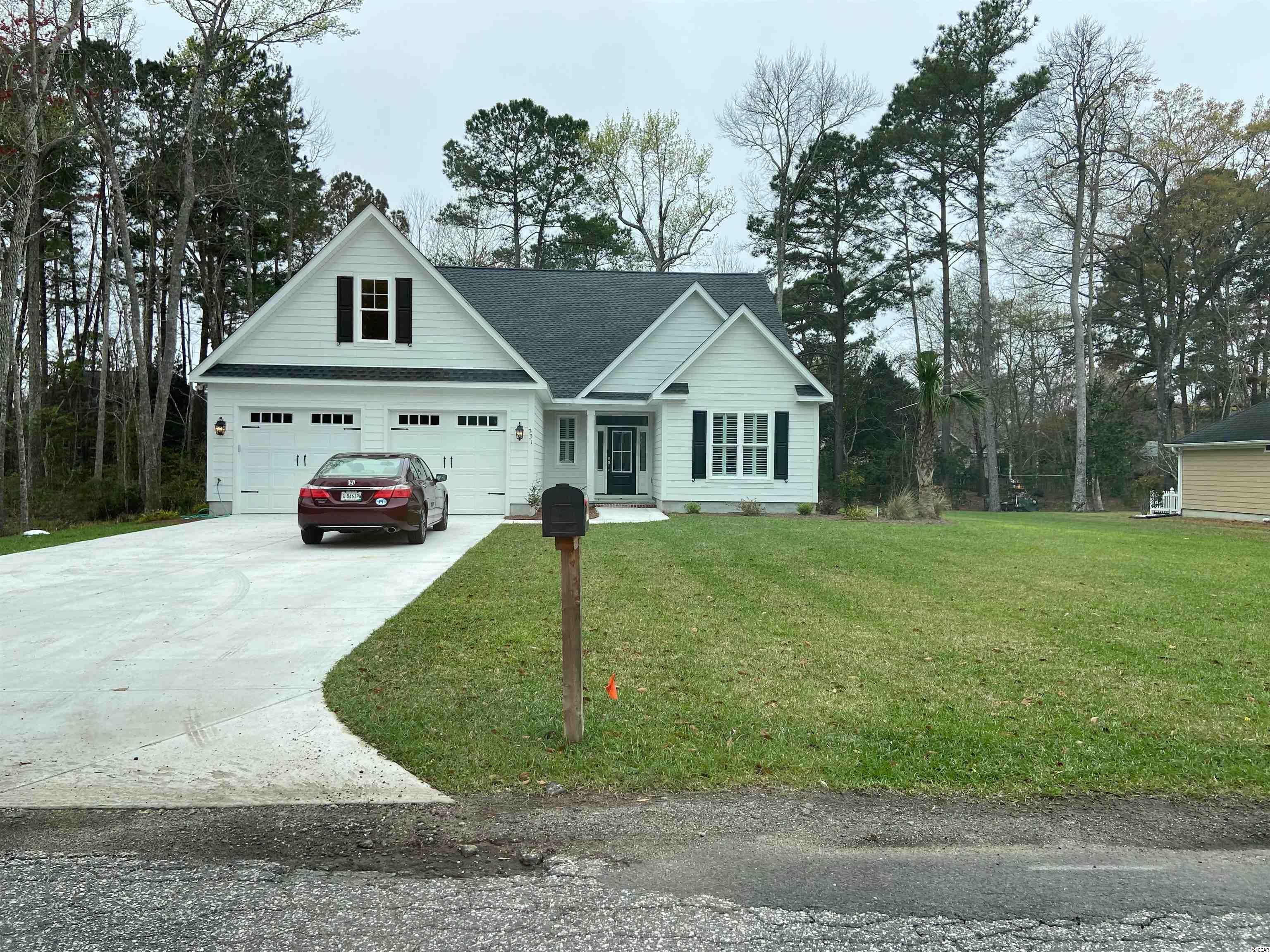 The Magnolia Model in Litchfield Country Club.  Great street with beautiful surroundings.  All the nice finishes you would expect.  Hardie Plank siding, LVP, tile, custom cabinets, solid surface counters, huge master shower, etc.  Larger than average garage for your storage.  You can't beat new construction.  Finishing up this summer.  Call today!!