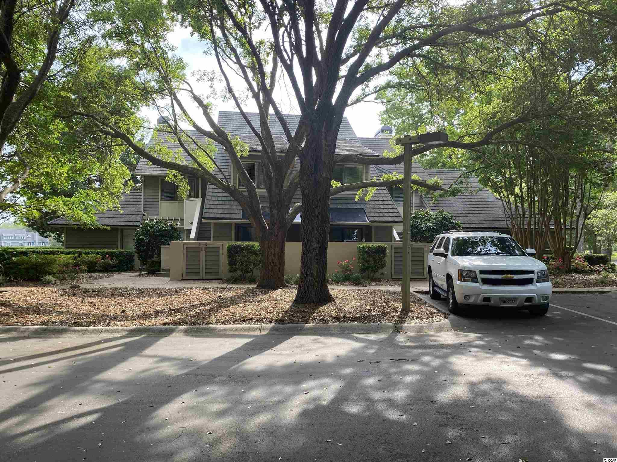"""You will fall in love with this three bedroom, three bath Richmond Park, LAKEVIEW villa, second floor unit has cathedral ceilings and no one over your head. This home has 18"""" tile flooring throughout for easy care.  Upgraded kitchen has granite counter tops, wood cabinets and stainless appliances.  All three baths have upgraded vanities with granite tops.  Master bath has a tiled, walk-in shower.  Located just a very short walk to the Richmond Park owners pool.  Very easy walk to the Richmond Park owners pool.  Very easy walk to the beach and the Embassy Suites Hotel.  The hotel features 2 pools, a fun filled water park and various dining venues.  Also easy walk to Kingston's Spa and Fitness Center which offers a heated, indoor pool, all the latest in workout equipment, tennis and pickle ball, a large putting green and all the soothing spa treatments.  Paradise found!"""