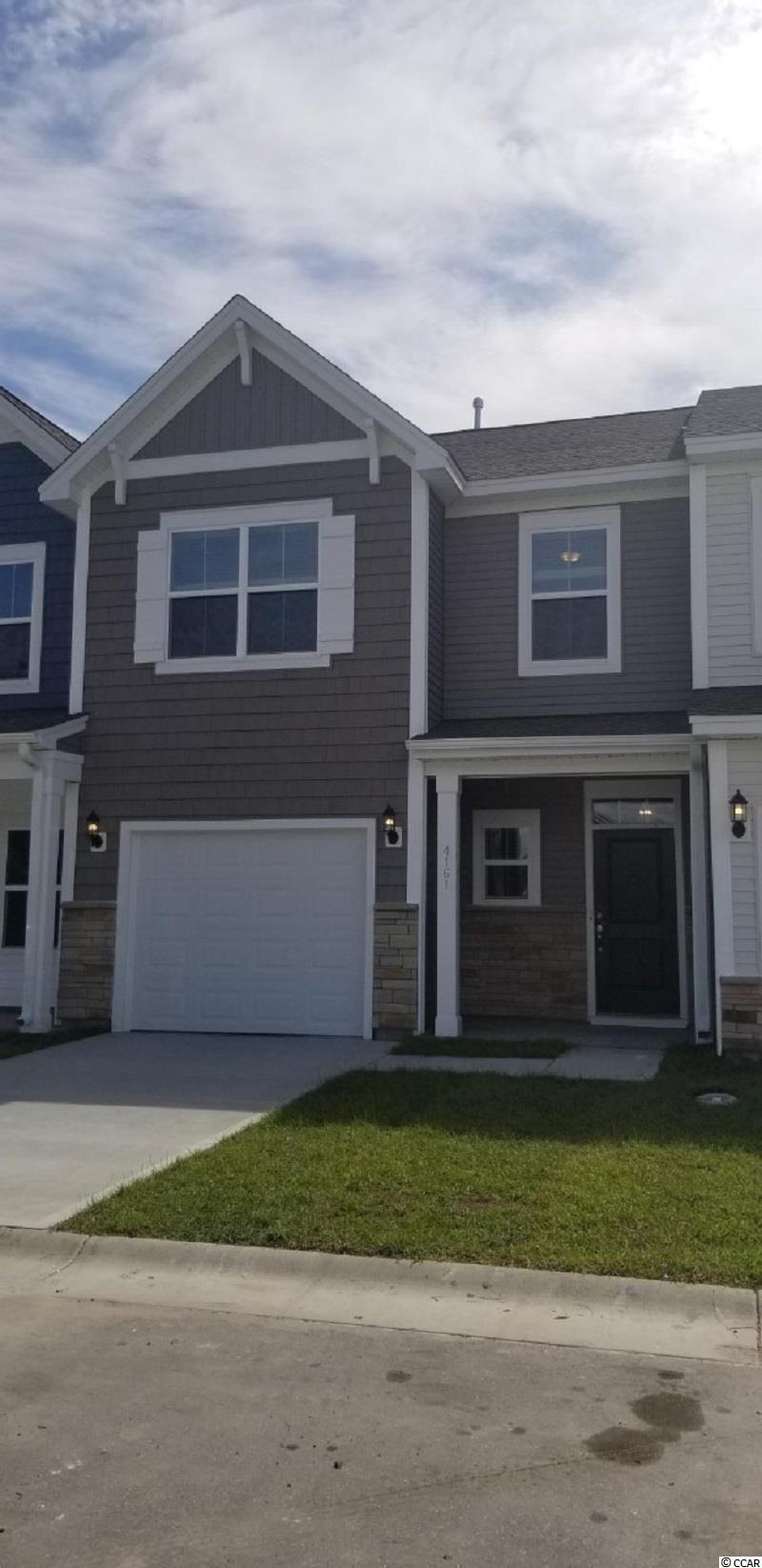This home boasts front and rear porches.  All bedrooms are located on the second floor.  Family room, dining area and kitchen are all open.  Luxury vinyl plank flooring is throughout the first floor, large storage/coat closet, powder room and a pantry also are on the main level. The family room includes a ceiling fan. The kitchen has white cabinets, quartz countertops, ceramic backsplash tile, a gas range and counter height island  The primary suite has a 5' shower, double bowl vanity, tray ceiling with ceiling fan, linen and walk-in closet. The two guest bedrooms share a bath with a tub/shower.  Also included is a tankless hotwater heater, attic pull down stairs with storage and a single car garage.  Lawn maintenance is included in the low HOA fees.  Sidewalks throughout the community.  Pool, clubhouse, fitness room, bocce ball, pickle ball, horseshoes, putting green, fire pit and fishing ponds for your enjoyment.  Summer completion!