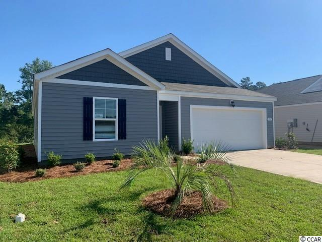 The Kerry plan is a spacious, one level home perfect for any stage of life. The open concept kitchen, living, and dining area with access to the covered rear porch from the kitchen is ideal for entertaining and grilling! This home will also have white painted cabinetry and all stainless Whirlpool appliances including a refrigerator. The split bedroom floorplan creates a private primary bedroom suite with a walk-in closet and spacious bathroom offering a double vanity and 5' shower. Blinds will be included throughout the house on all standard sized windows and the living room and all bedrooms will be pre-wired for cable and ceiling fans. Two-car garage with garage door opener plus our QuickTie framing system. It gets better- this Home Is Connected! Control the thermostat, front door light and lock, and video doorbell from your smartphone or with voice commands to Alexa. Pine Forest offers spacious homesites with a country feel, but is just a short drive away from the historic city of Conway, quaint town of Aynor, and all of the Grand Strand.  *Photos are of a similar Kerry home. (Home and community information, including pricing, included features, terms, availability and amenities, are subject to change prior to sale at any time without notice or obligation. Square footages are approximate. Pictures, photographs, colors, features, and sizes are for illustration purposes only and will vary from the homes as built. Equal housing opportunity builder.)