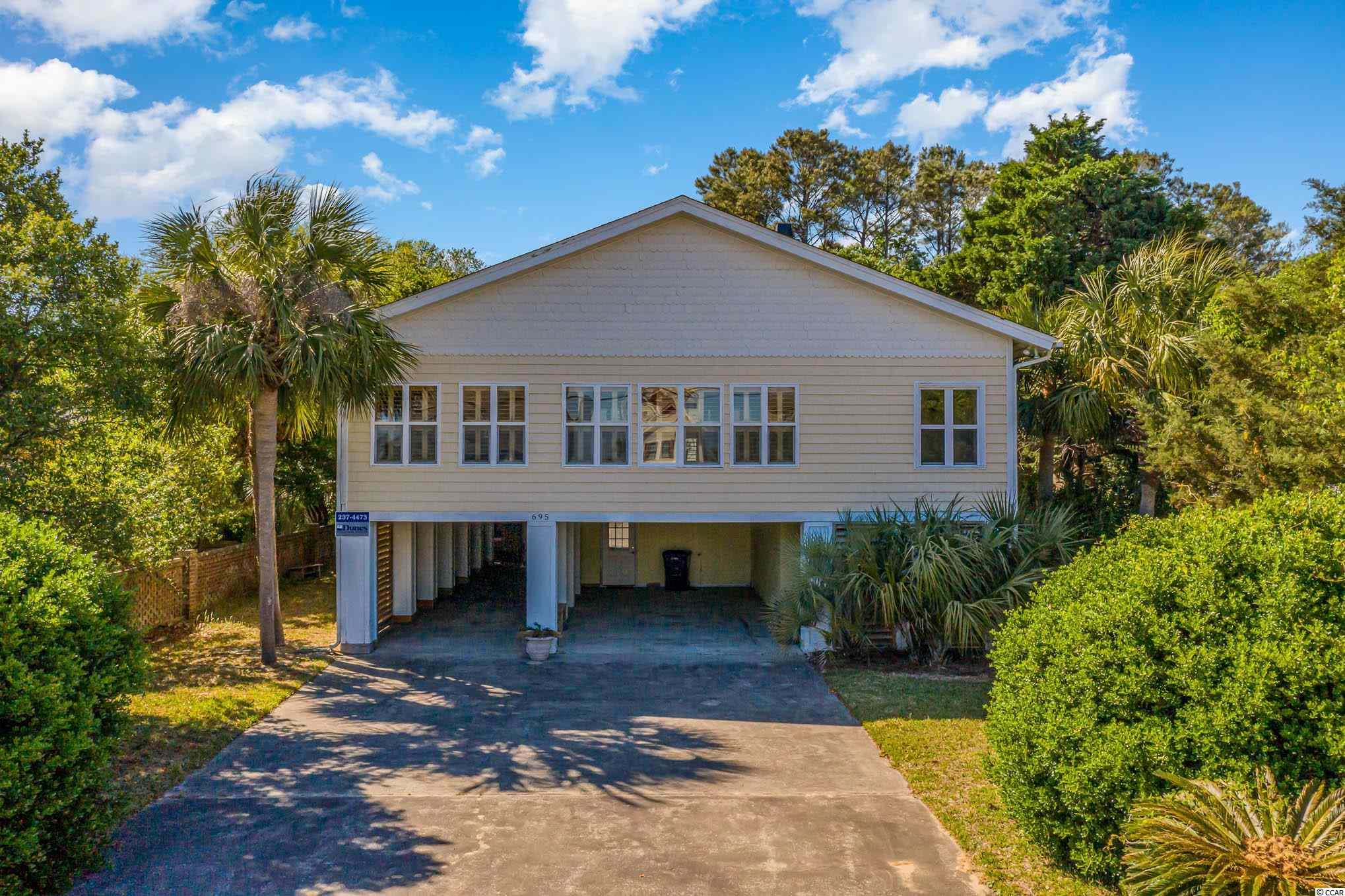Huge 3 story home just steps to the Atlantic Ocean in coveted Pawleys Island! Enough room for your entire family to visit, with 5 bedrooms and 4 full bathrooms. large deck coming of the home, covered outdoor shower, tons of parking, and you're close to all major shopping & attractions without being in the middle of busy Myrtle Beach. This property is truly a little slice of heaven. Call today for more information or to schedule a showing.