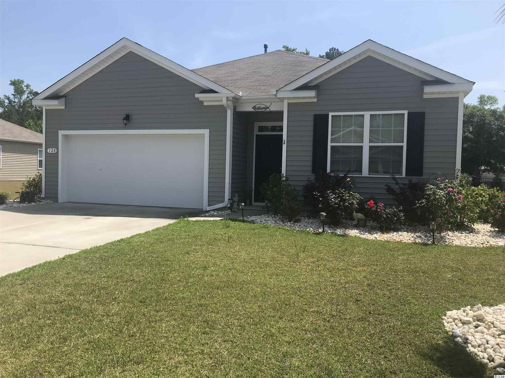 Your cooking with gas in this natural gas community!  Move in ready 4 bedroom/2 bath home in mint condition.  Located just off hwy 90 and close to International Drive makes your commute to Myrtle Beach or hwy 501 convenient.  This 3 year old home features a fenced backyard with a lovely view of the pond.  Screened in back porch leads to an expanded patio area great for barbecues or family gatherings.  Master bath offers a walk in shower and large walk in closet.  Open floor plan is another added plus. Owner added in a full house Aquasana Water system.  Schedule your showing today!