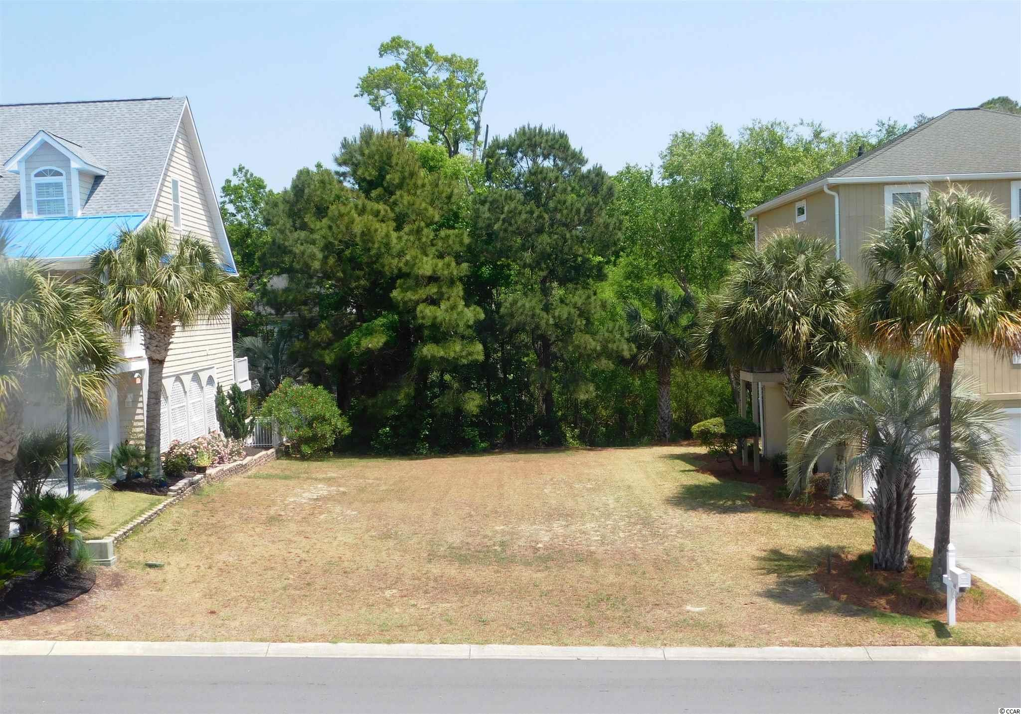 Absolutely beautiful building lot in desirable Palms at 5th Avenue South.  A beautifully maintained community on ocean side of Highway 17, which affords owner walking or golf cart riding to the ocean, shops, post office, restaurants, dancing, etc. in the heart of North Myrtle Beach.  HOA fees are low-low and lot is one of closest in the community to the ocean.  See it- you'll want it for your perfect beach cottage- close to the shore.   No set time to build.  Buy now, build later. Listing agents are also the owners/sellers of the property.