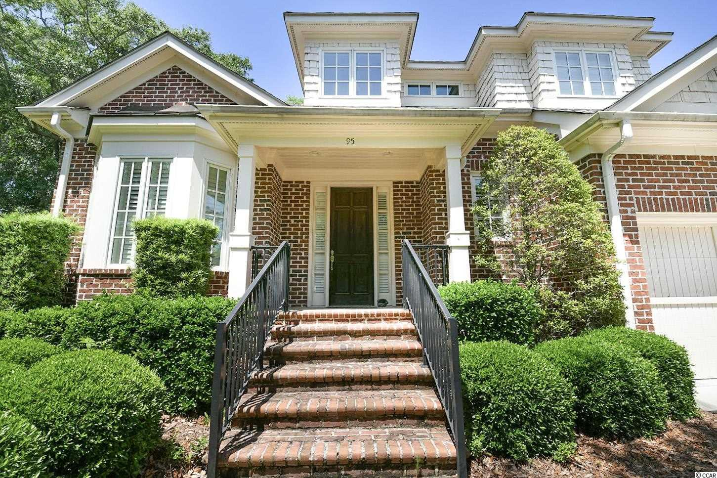 Welcome to 95 Harborclub Dr. in Pawleys Island's prestigious Reserve community. This 3 bed/3.5 bath luxury townhome has many upgrades and has been occupied very little since construction. The home has beautiful hardwood flooring downstairs, a custom trim package and a large living room with a vaulted ceiling, built-ins and a gas fireplace. The kitchen is open to the dining area and has attractive granite counters and an island with gas cook-tops. The master bedroom is located on the ground level and has a very spacious bathroom with dual sinks, a soaking tub and large tiled shower. Also on the ground floor is a powder room, laundry room and a beautiful Carolina room facing the back yard. As you reach the second level, you'll enter a large sitting area that can be used as a second living room or a game room. Two more generously sized bedrooms are located upstairs, both with private full bathrooms. The second level also offers plentiful storage and an office area. Whole-house generator added by the owner.   Owners and guests are only a short walk away from The Reserve Harbor Yacht Club and Marina, where members enjoy wet or dry boat slips, a waterfront bar/restaurant and swimming pool. Owners can also access Litchfield by the Sea's private beach by golf cart, automobile or bicycle. Don't miss this opportunity to own a highly sought-after Harbor Club Villa in The Reserve.