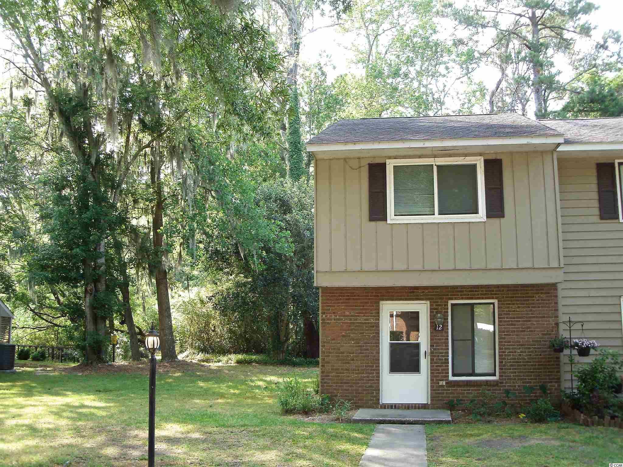 Only 3 miles from the ocean! Great second or primary home. Townhouse-style condo boasts end position with long view over lovely, woodland-edged pond. Two-story layout offers common areas on the ground level including powder room, fireplace and enclosed all-season porch. Top floor has two bedrooms and a full bath. Utility room/closet is available for washer and dryer. Great central location with direct access to the county bike path. Convenient to medical facilities, schools, shopping, golf courses and restaurants.