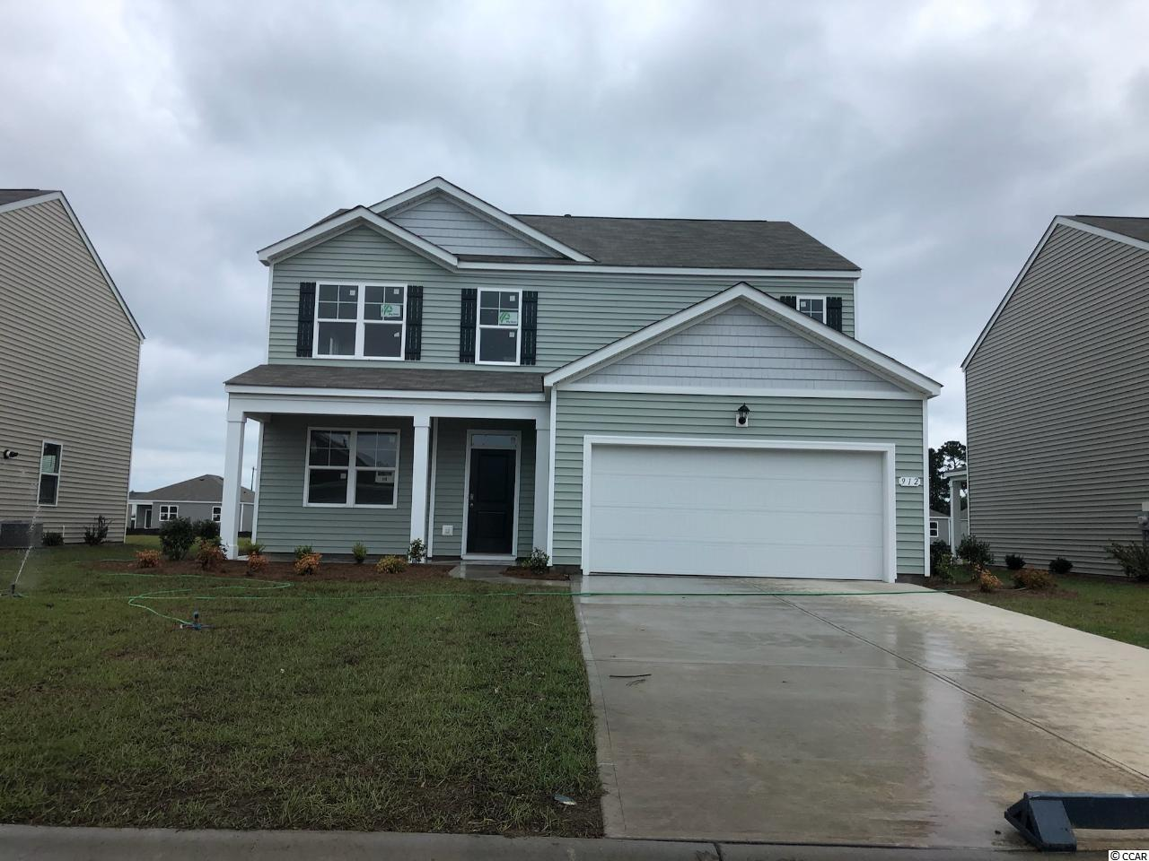 Oyster Bluff is now selling! Brand new natural gas community just minutes away from shopping, dining, and the beach. The Elle floor plan offers plenty of space with room to grow. Featuring a first floor primary bedroom suite with generous bath, walk-in closet, and linen closet. The kitchen boasts a large island with breakfast bar and opens to the casual dining area and spacious family room. Granite countertops, off-white painted cabinetry, stainless Whirlpool appliances, and beautiful laminate wood flooring throughout the main living areas all included! There is also a study with French doors on the main level for a perfect home office space while sliding glass doors off the dining space lead to the rear covered porch with pond views for a seamless transition from indoor to outdoor living. The upstairs offers four large bedrooms, two full bathrooms, plus an expansive secondary living area. Tankless gas water heater, two-car garage with garage door opener, and our QuickTie framing system also included. It gets better- this is America's Smart Home! Ask an agent today about our industry leading smart home technology package that is included in each of our new homes.  *Photos are of a similar Elle home. (Home and community information, including pricing, included features, terms, availability and amenities, are subject to change prior to sale at any time without notice or obligation. Square footages are approximate. Pictures, photographs, colors, features, and sizes are for illustration purposes only and will vary from the homes as built. Equal housing opportunity builder.)