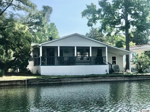 Home is absolutely beautiful located on a lake watching the swans swim by.  Home has been updated and will go fast !  Freshy painted in popular grey with GRANITE  kitchen counters and new cabinetry.  Storage shed and ample parking.