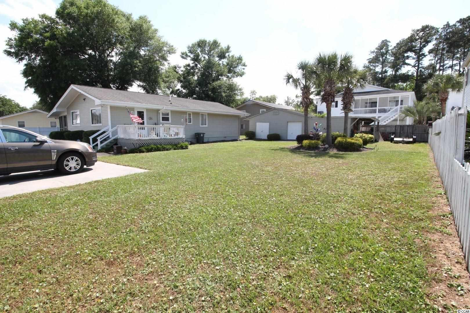 Nice cozy 4Br/2Bath home that is (3-1/2 Blocks) walking distance to the beach, Sea Mountain Hwy and Boulineau's. Large screened porch, 12x12 Deck, 16x40 Shed, excellent living space. SOLD WITH ADDITIONAL LOT NEXT DOOR. Properties in this area don't come on the market very often. BRING ALL OFFERS!