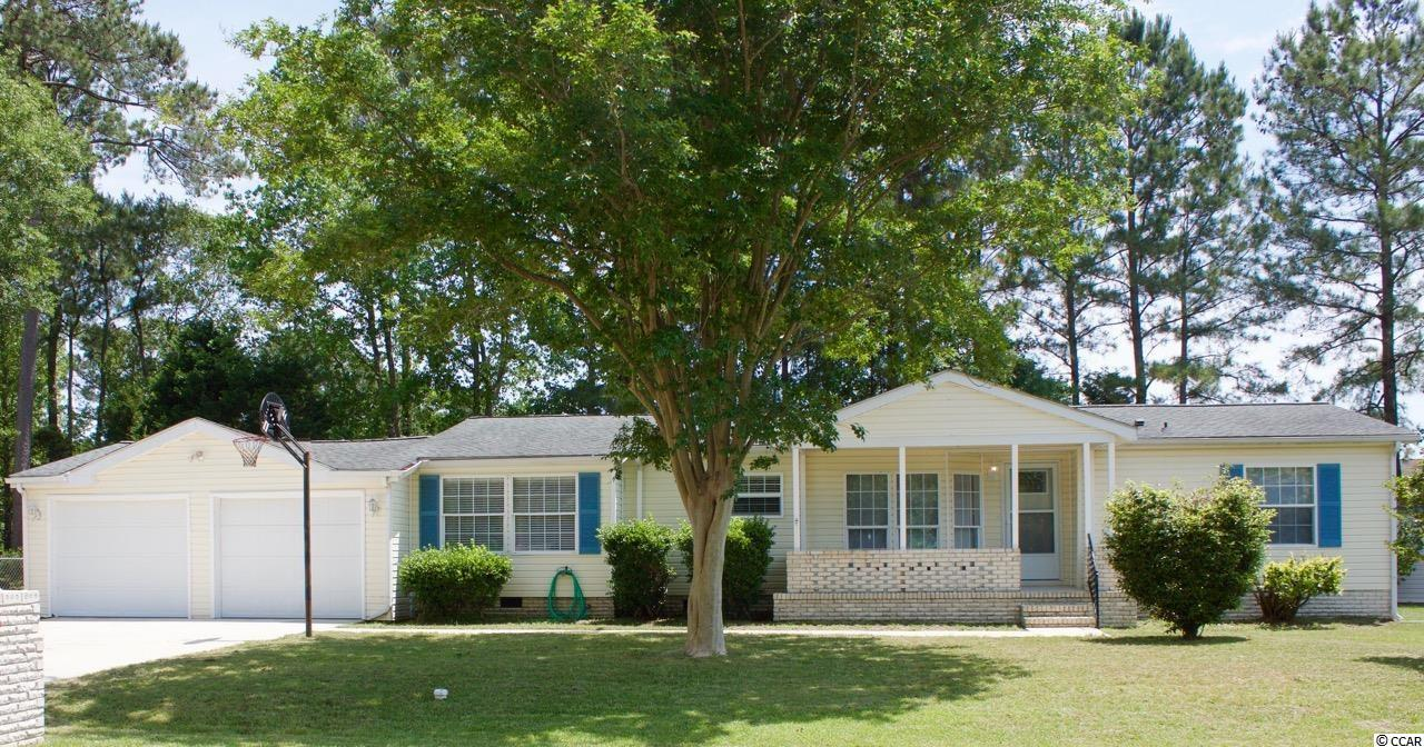 Don't miss this adorable well maintained 3 bedroom, 2 bathroom Palm Harbor  home in the quiet North Pointe Community. This home has been freshly painted throughout. New flooring installed and fenced in backyard. This home also offers a sunroom in the back of the house, large covered front porch and a 2 car garage. Low HOA's and a community pool for those hot summer days. Perfect location situated between North Myrtle Beach High School and North Myrtle Beach Middle school. Only minutes to the beach, North Myrtle beach sports complex and highway 31. All measurements are approximate and buyers are responsible for verification.