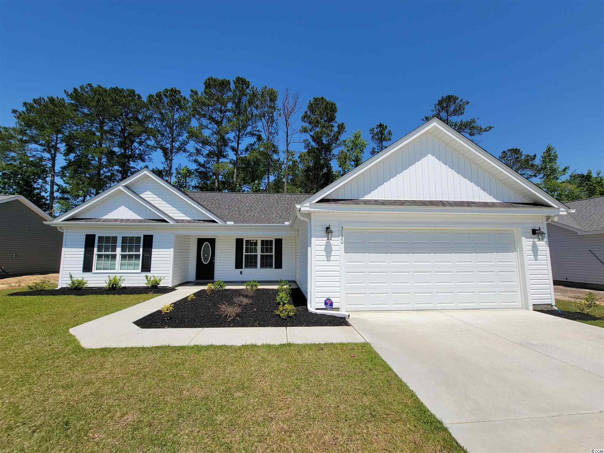 "This Kingston Plan with 3 BR 2 Bath and 2 Car Garage home offers a great open floor plan at 1550 Heated Square Feet with plenty of windows and natural light. This Beautiful Kingston Plan is locatd in Woodland Lakes in Conway, SC. Woodland Lakes is a Natural Gas Community located in Conway, South Conway just minutes to Historical Downtown Conway, Coastal Carolina University, and Conway Medical Center. Plan offers all of the right features and benefits.  Features include but are not limited to 3 Bedrooms 2 Baths, 2 Car Garage, Great Open Floor Plan, Vaulted and Trayed Ceilings, 2 Ceiling Fans, Plant Shelf, and Vinyl Windows, Plans also include Separate 10x14 Concrete Patio, Screened Porch, Carolina Room Sidewalks to Front Entry and Driveway. This home includes      the luxury of a Tankless Hot Water Heater, Gas Heat, Gas Stove and Oven. This Home also includes 36"" Profiled Kitchen Cabinets with Top Molding Trim and Door Knobs, Stainless Steel Appliances, Kitchen Pantry, Linen Closet, Completely Trimmed and Painted Garage with Drop Down Storage Access, which is Floored for your convenience, and Electronic Garage Door with Remote Openers. Interior window and door trim, ""Low E"" Energy Efficient Windows, Upgraded Insulation Package, Landscaped, Sodded Yard, and Irrigation (Automatic Yard Sprinklers) and so much more. This home in Woodland Lakes is built with a ""Maintenance Free"" Lifestyle in mind. Woodland Lakes is South Conway's Newest Community conveniently located near Shopping, Medical Offices and Hospitals, Restaurants, and Schools.   Call the Onsite Model for New Homes Availability and to make an Appointment to see this Kingston Plan in Woodland Lakes."