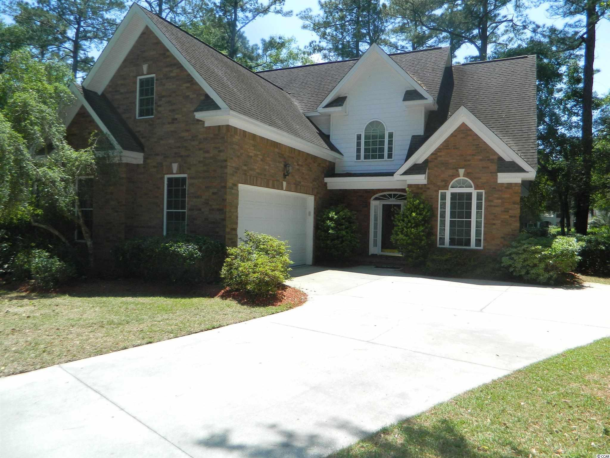 This all brick home is located in the highly desirable gated community of Heritage Plantation. Master bedroom is downstairs with a half bath. Two more bedrooms upstairs with a large bonus room. This house has a screened in porch that has been converted into a 3 season room with plenty of privacy. The backyard patio is an ideal area to grill out. This is a golf course community and has many amenities such as a pool, clubhouse, tennis courts and access to the marina located in Heritage Plantation.