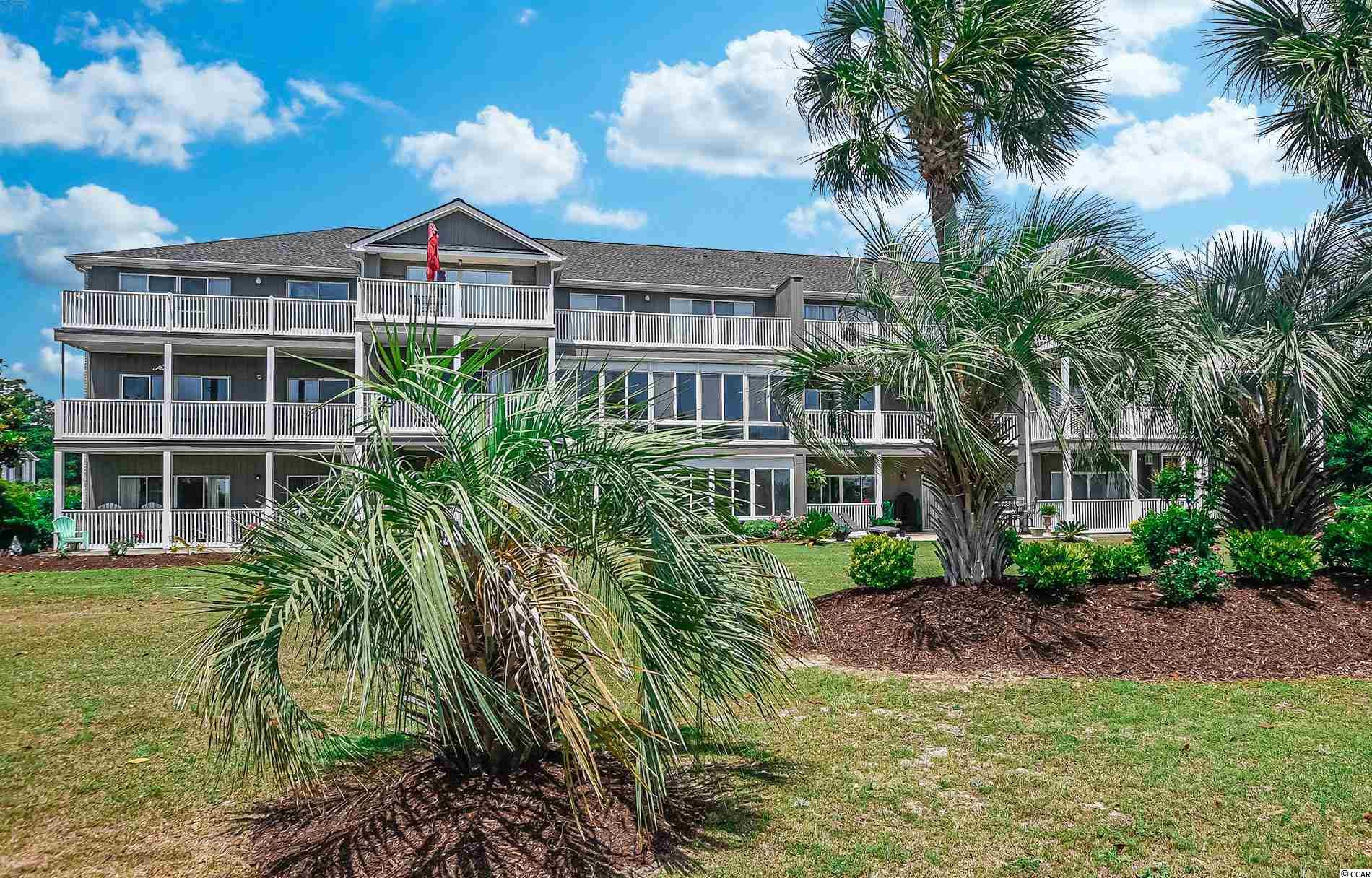 Amazing opportunity to own this gorgeous second floor end unit in Carolina Yacht Landing.  This is a gated waterway community with available boat storage, boat slips, and golf carts allowed.  There are 2 pools, fitness center, BBQ areas, and water fountains throughout the spacious grounds.  Your condo features a large porch for enjoying the SC weather.  Inside has updated flooring, paint and a light, airy, beach feel.  Located very close to restaurants, shops, entertainment, golf, and of course the sand of Cherry Grove Beach.  This condo is an absolute gem and perfect for a permanent residence or vacation get-away.