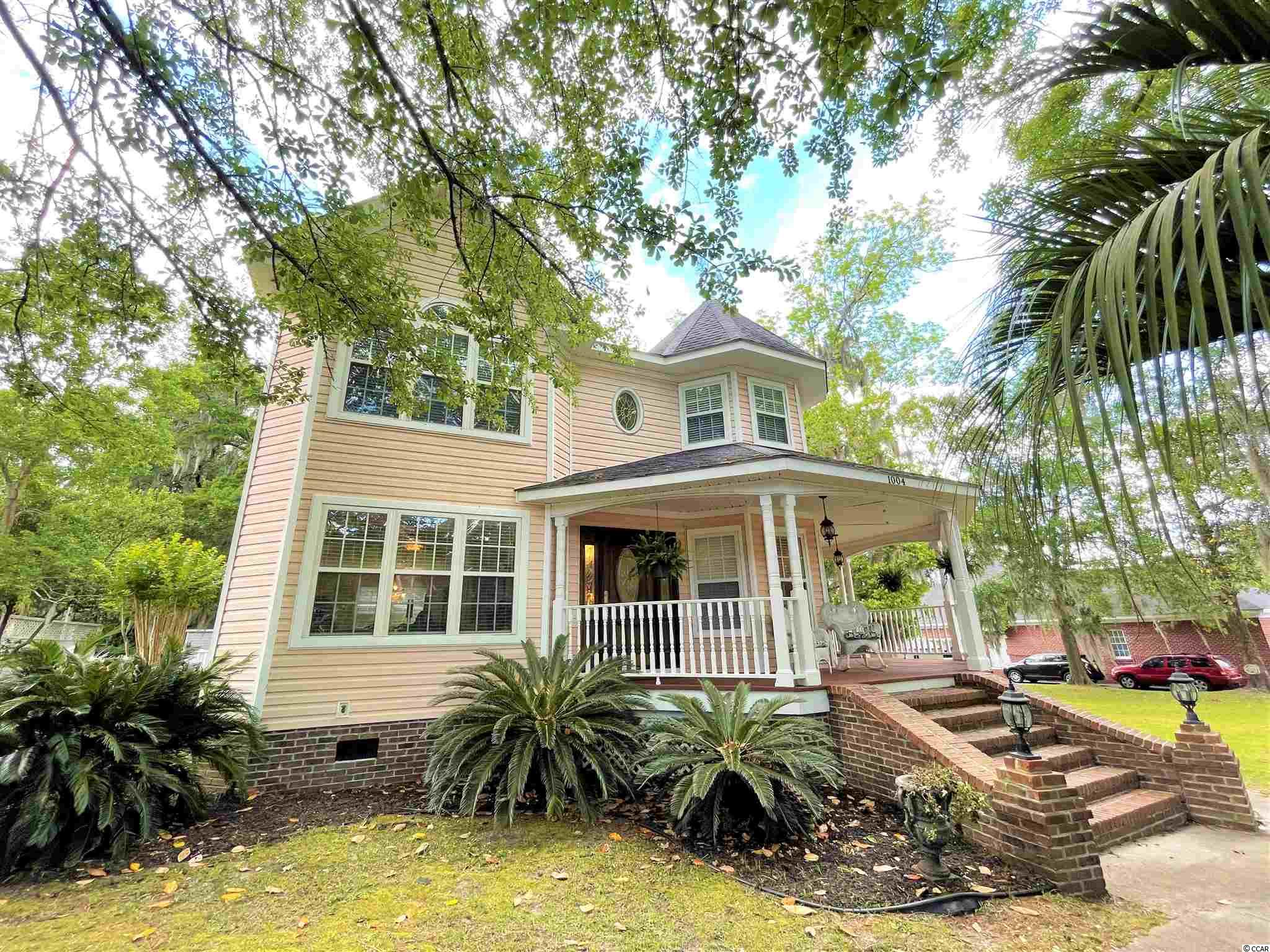 Homes in Conway's much sought after Historic District rarely come on the market. This lovely Victorian home on 0.41 acres with NO HOA has a welcoming front porch and many interior upgrades. You'll love the solid oak hardwood flooring throughout the home, smooth ceilings, new stainless appliances, custom fit blinds, and crown molding throughout. The home is ideal for entertaining with a formal dining area, spacious kitchen with breakfast nook, and bar area. Downstairs also includes a half bath and a flex space perfect for an office or craft room. The living room has a fireplace that is currently wood burning, but gas is available at the street if you wanted to convert it. Upstairs, you'll find the master suite, bedrooms 2 and 3 that share a connecting bathroom, and the laundry room. Outside you'll find a large deck and gazebo, 2 detached storage buildings, and mature oak trees. Conveniently located just 1 block to the Conway Library, and 4 blocks to downtown Conway, you can enjoy all that Conway has to offer. Shopping, dining, the Conway River Walk, and more are literally a golf cart ride, super short drive, or walk away!