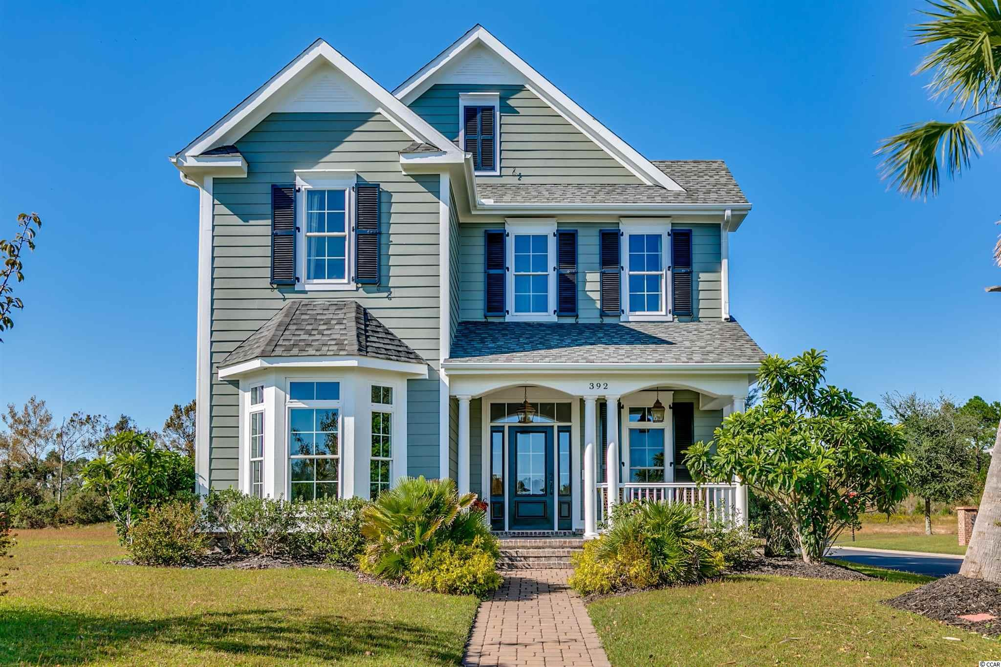 If you are looking for a high end, top quality home in a convenient gated neighborhood, look no further! No corners were cut whenbuilding this custom, one of a kind, Charleston Style beauty. This home is situated on one of only 4 oversized corner lots and isacross the street from the Intracoastal Waterway. The exterior is hardy plank and brick and offers operable shutters in the front ofthe home. Inside you will find South American Walnut hardwood floors (recently refinished) throughout all living areas andtravertine and marble flooring in the laundry room and baths. Bedrooms offer carpet. The layout and flow of this home isexceptional with 10 ft. ceilings on the first floor and 9 ft. on the second floor. From the front door you walk into a beautiful entry/sitting area. To the left you will find a large formal dining room that transitions to the kitchen with a beautiful wet bar/Butlers pantry.The kitchen overlooks the breakfast nook and great room and has solid wood cabinets with slam proof drawers, SS appliances,and beautiful granite countertops. The great room offers a fireplace, surround sound and many recessed lights. The Carolinaroom is also on the main living level with french doors leading to the private courtyard. The courtyard is fenced-in with gas line tothe grill and electricity for an outdoor fountain. The separate first floor laundry room offers custom solid wood cabinetry and graniteas well as a sink and an abundance of cabinets. Above the garage you will find an oversized bonus room/4th bedroom with 1/2bath. A second staircase will lead you to the the Master Suite and 2 additional nice sized bedrooms. There are 3 closets in theupstairs landing as well as a linen closet in the 2nd full bath. The master suite is complete with his and hers custom closets ( allclosets in the home are custom), a floor to ceiling travertine shower and large jacuzzi tub. The second bath offers high endfinishes as well, including a tub with tiled backsplash, granite, traverti
