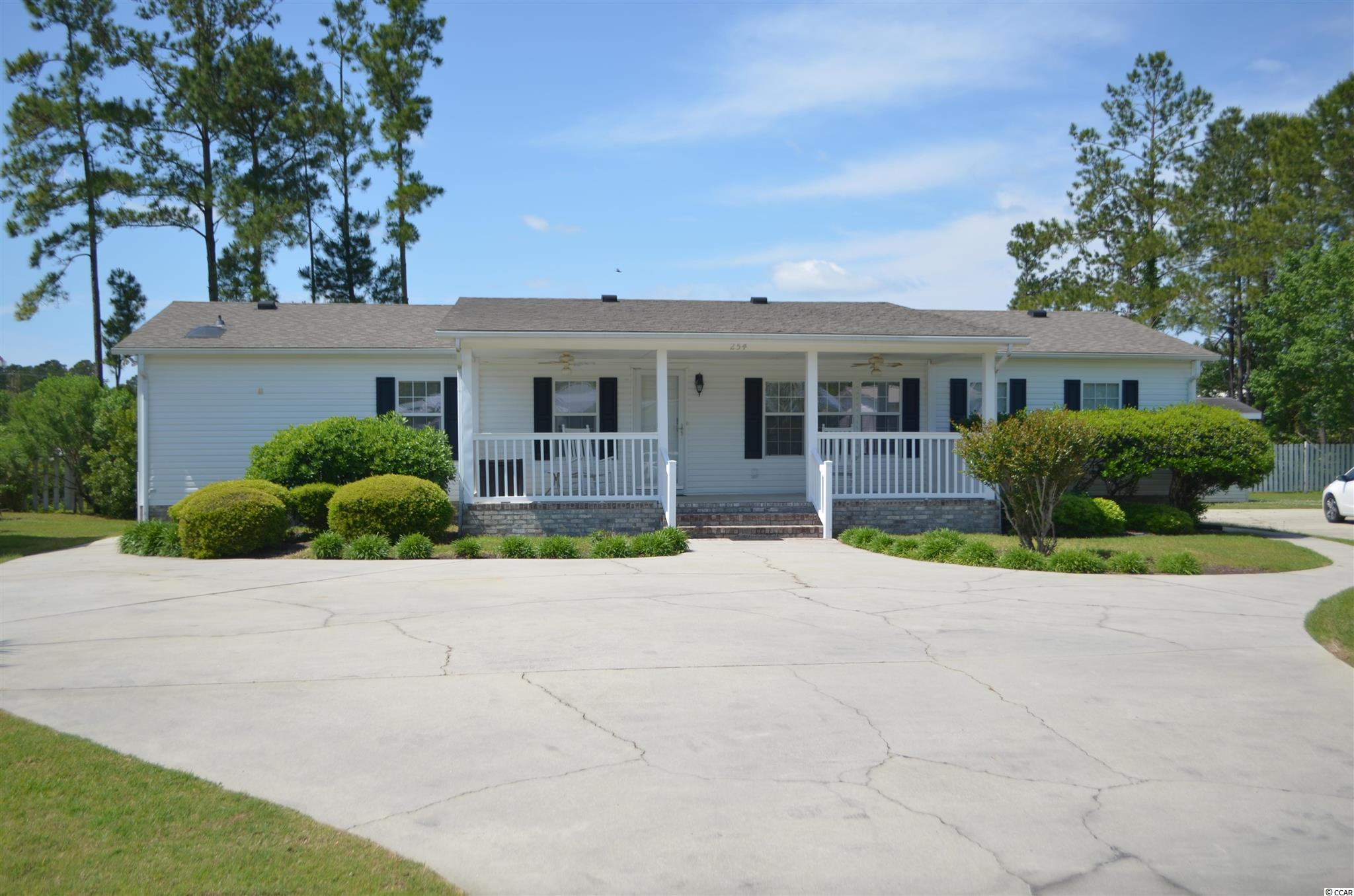 Welcome to this Beautiful and Spacious 3 Bedroom 2 Bath Home in Little River.  The home features a Large Living Room and Family Room with Fireplace.  The Master Bedroom is perfect size for a King Size Bed, and has an attached Office/Nursery or can be used as a Sitting Room.  The Split Bedroom Plan features two large guest rooms as well.  Enjoy relaxing under the covered porch out front or on the Back Porch with a Retractable Awning.  Two Storage buildings on property perfect to house Lawn Equipment and for overflow storage.  Low HOA and just 5-10 minutes to Shopping in North Myrtle Beach and the Atlantic Ocean. Come see this today