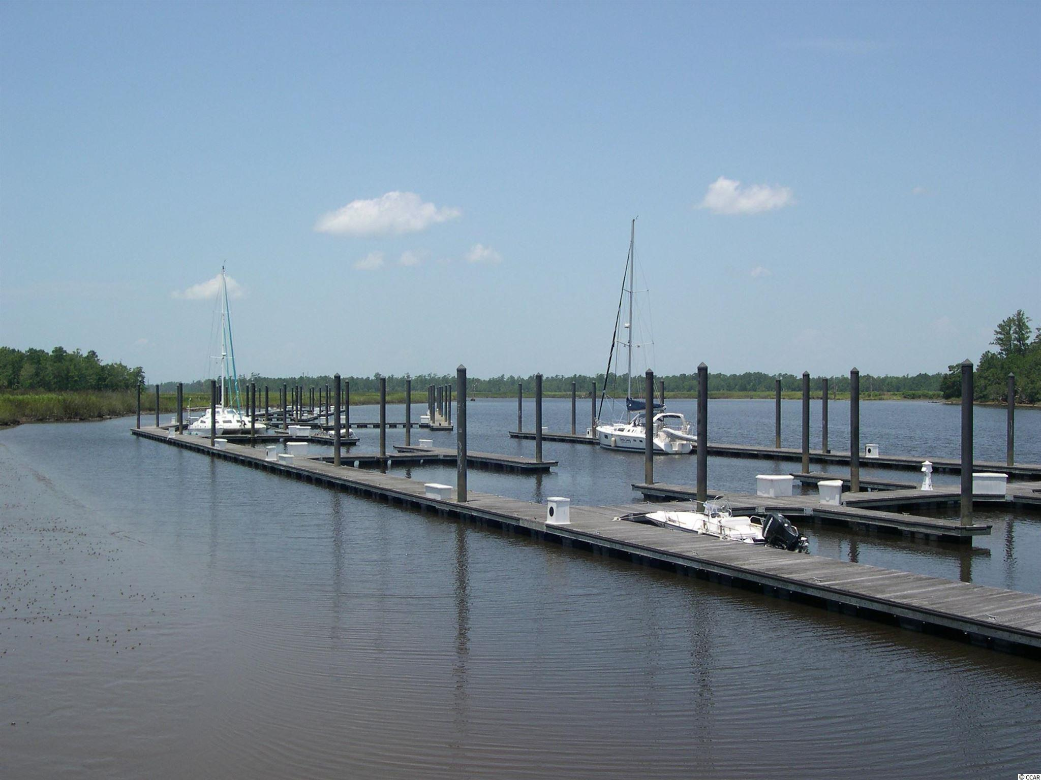 This is a 30 foot boat slip (#61) in Friendfield Marina at Harmony.  You must own a lot in Harmony in order to purchase a boat slip.         Harmony is located about 4 miles out of Georgetown and about 70 miles from Charleston.  The Georgetown regional airport is about 2 miles away.   Harmony is a quiet community with miles of walking paths and a deep water marina.
