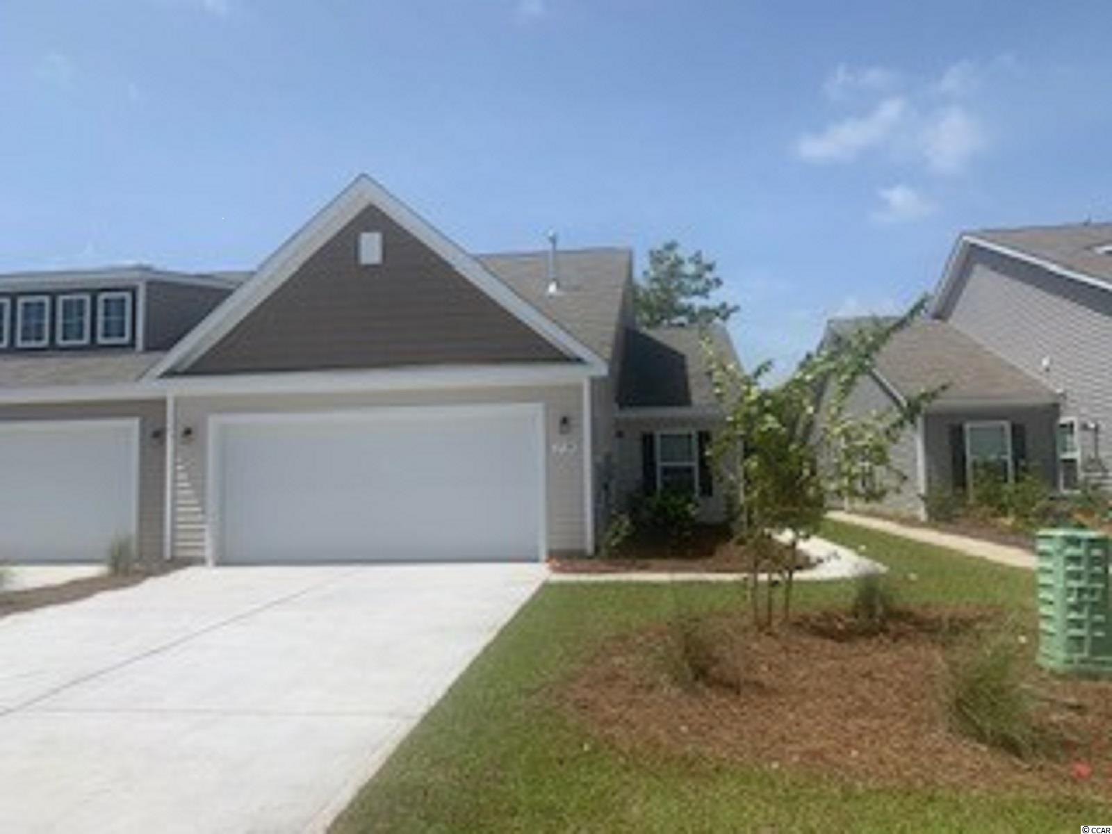 """Enjoy the laid back coastal lifestyle where all of your exterior maintenance is taken care of! A rare opportunity of a duplex being offered in Carolina Forest that also features an attached two-car garage. Upon entry you are greeted with a very open layout and high vaulted ceilings. The split bedroom floor plan offers privacy when you have guests visiting you at the beach, along with functionality. This home will also feature a spacious rear covered porch with pond views that is great for morning coffee! Granite countertops, tankless water heater, 36"""" painted cabinetry, stainless Whirlpool appliances with a gas range, and our QuickTie framing system all included. This is America's Smart Home! Ask an agent today about our industry leading smart home package that is standard in every home.  *Photos are of a similar Tuscan home. (Home and community information, including pricing, included features, terms, availability and amenities, are subject to change prior to sale at any time without notice or obligation.  Square footages are approximate.  Pictures, photographs, colors, features, and sizes are for illustration purposes only and will vary from the homes as built.  Equal housing opportunity builder.)"""