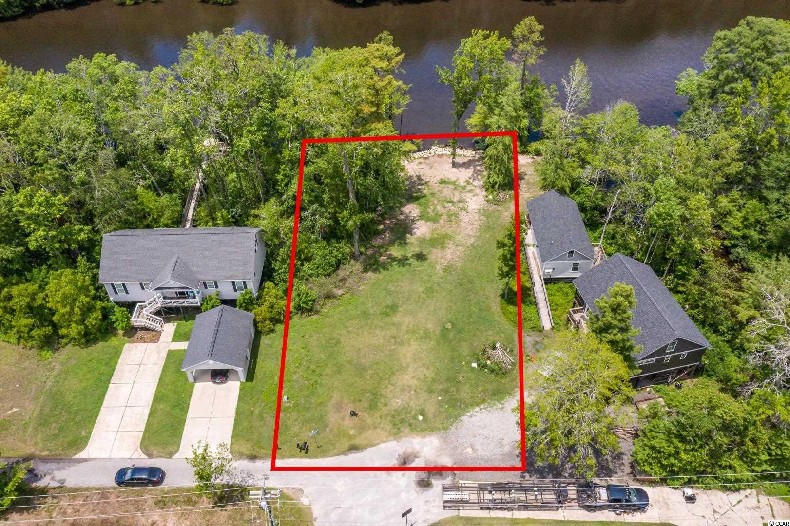 Don't miss this rare opportunity to build your dream home on this .45 acre riverfront lot in this quiet waterway community with NO HOA! This lot has been cleared, has utilities to site, and also includes a seawall so you are ready to start building. Park your boat right at home with the availability to build a dock on this property! Perfectly situated close to all of the Grand Strand's finest dining, shopping, golf, and entertainment attractions, with easy access to highway 707 and highway 17.